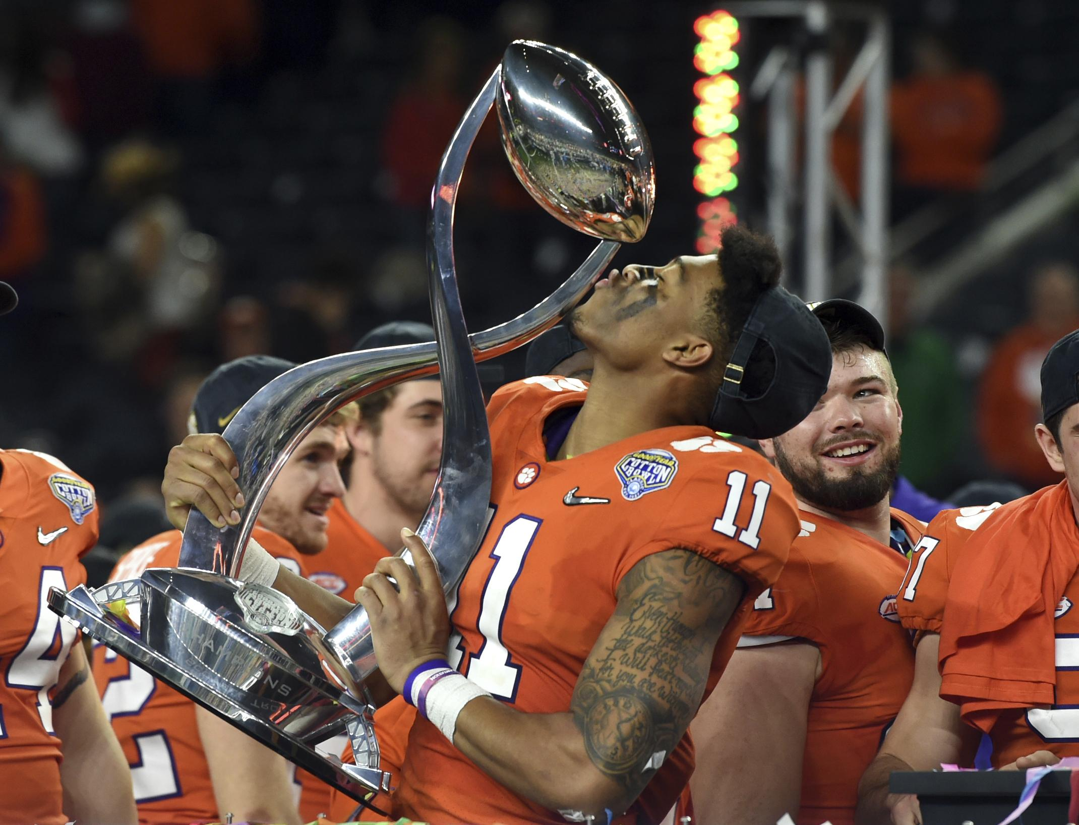 Clemson safety Isaiah Simmons (11) kisses the trophy as he and his  teammates celebrate 60f2f4d2e