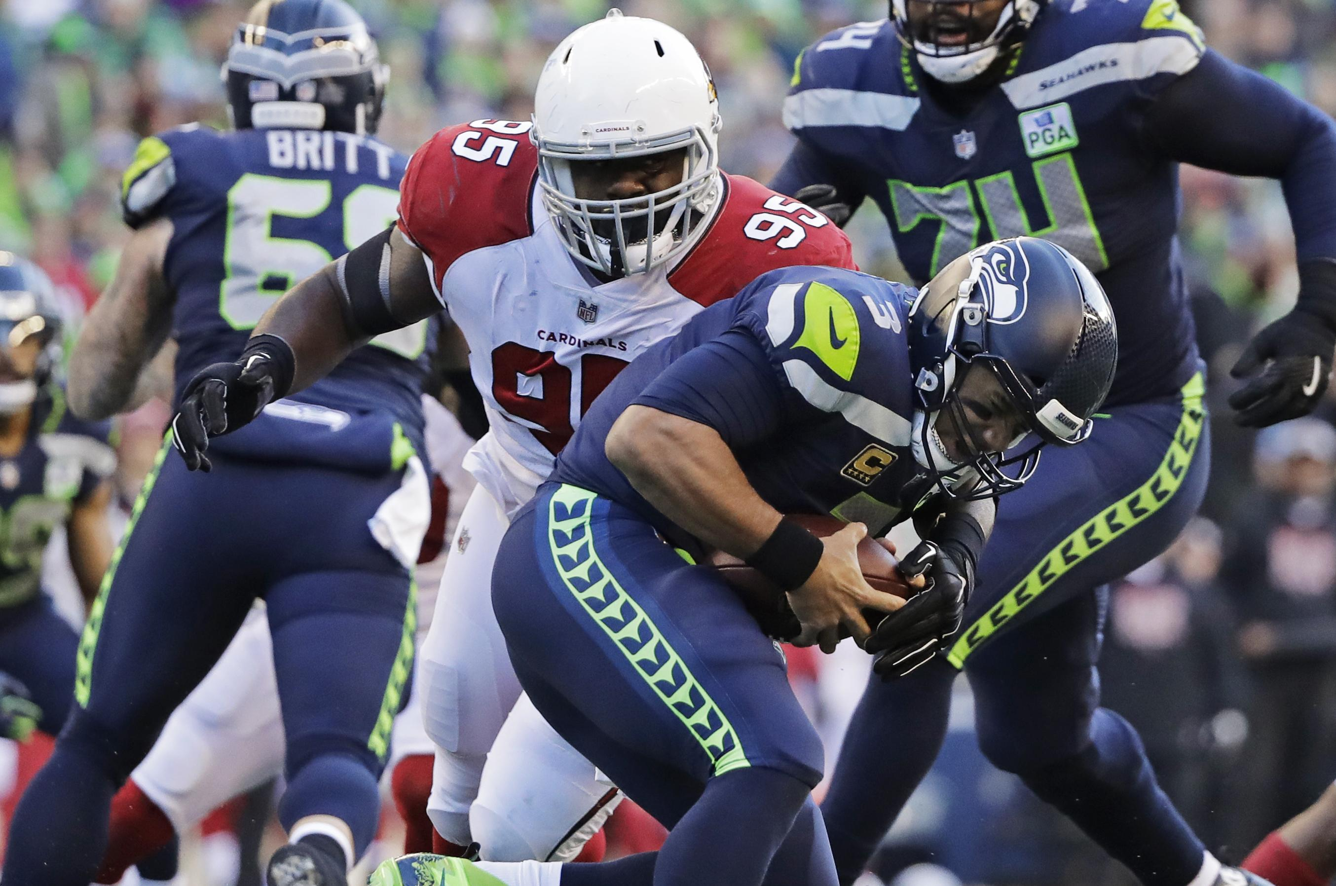 9e61094a69f Seahawks quarterback Russell Wilson absorbed plenty of punishment from the  Arizona Cardinals, but Seattle's offensive