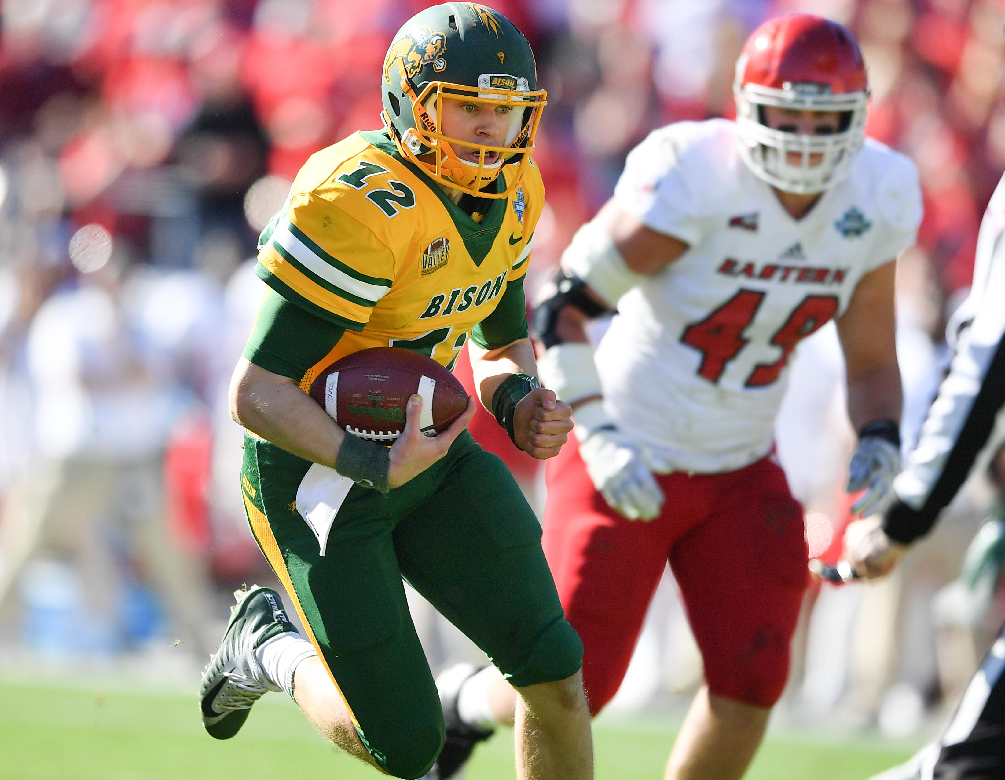 North Dakota State Quarterback Easton Stick Runs For A Touchdown During The First Half Of The