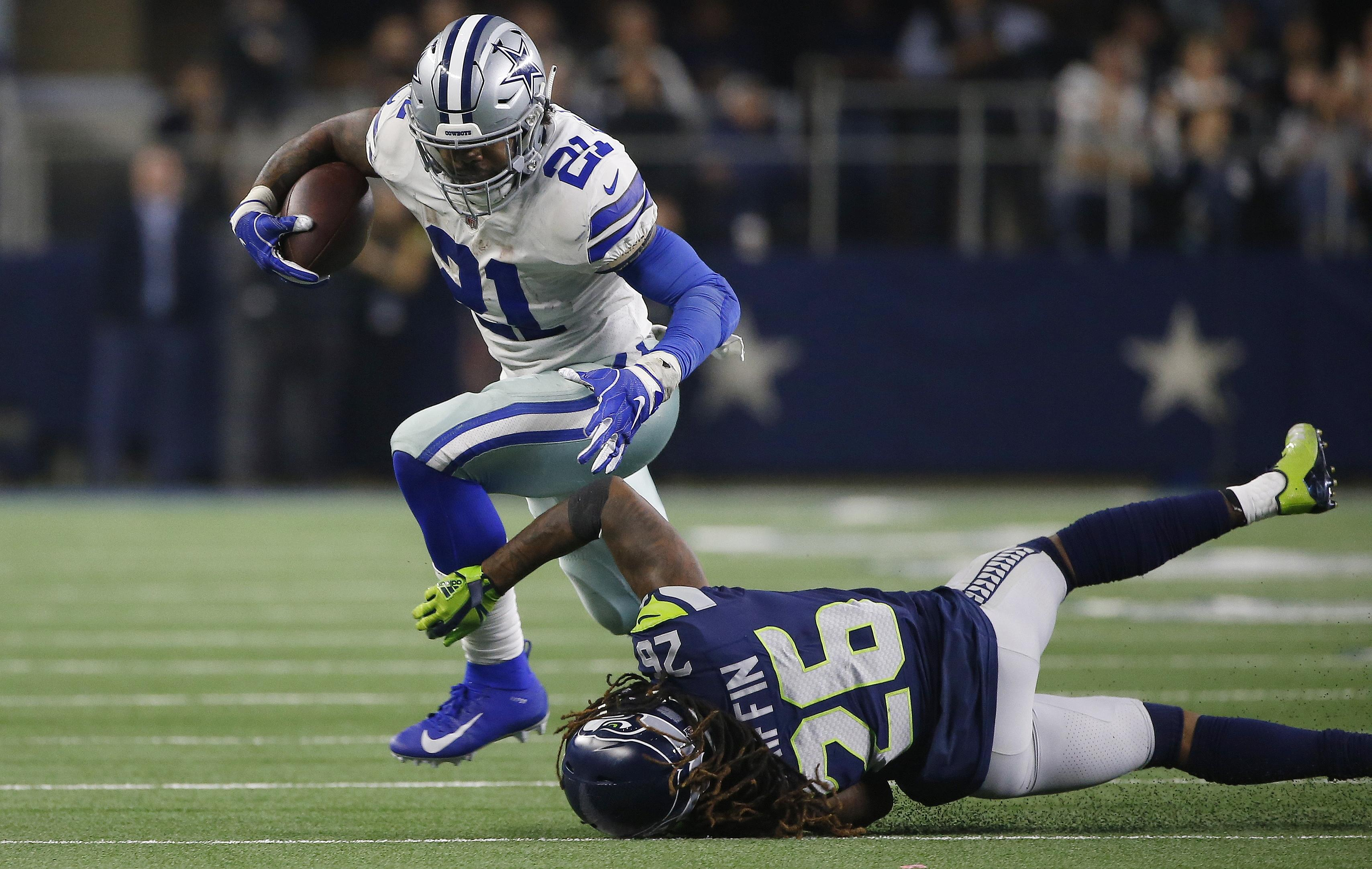 Dallas Cowboys running back Ezekiel Elliott runs near Seattle Seahawks  cornerback Shaquill Griffin during the second 30f389c3e
