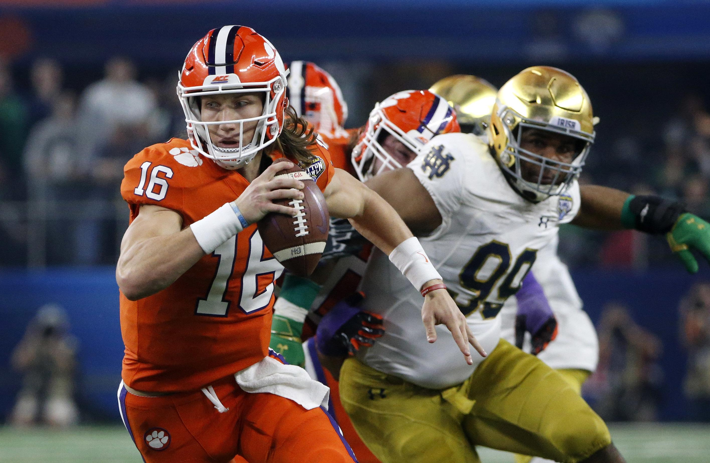 Clemson quarterback Trevor Lawrence scrambles out of the pocket during the  Cotton Bowl against Notre Dame 45fda8626