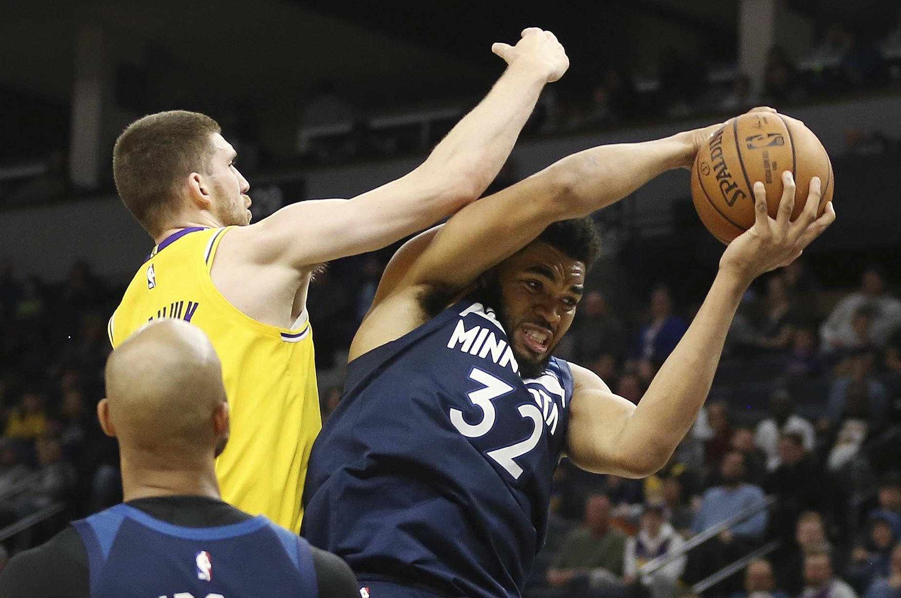 f2a599edcd9 Minnesota Timberwolves  Karl-Anthony Towns (32) rebounds against Los  Angeles Lakers