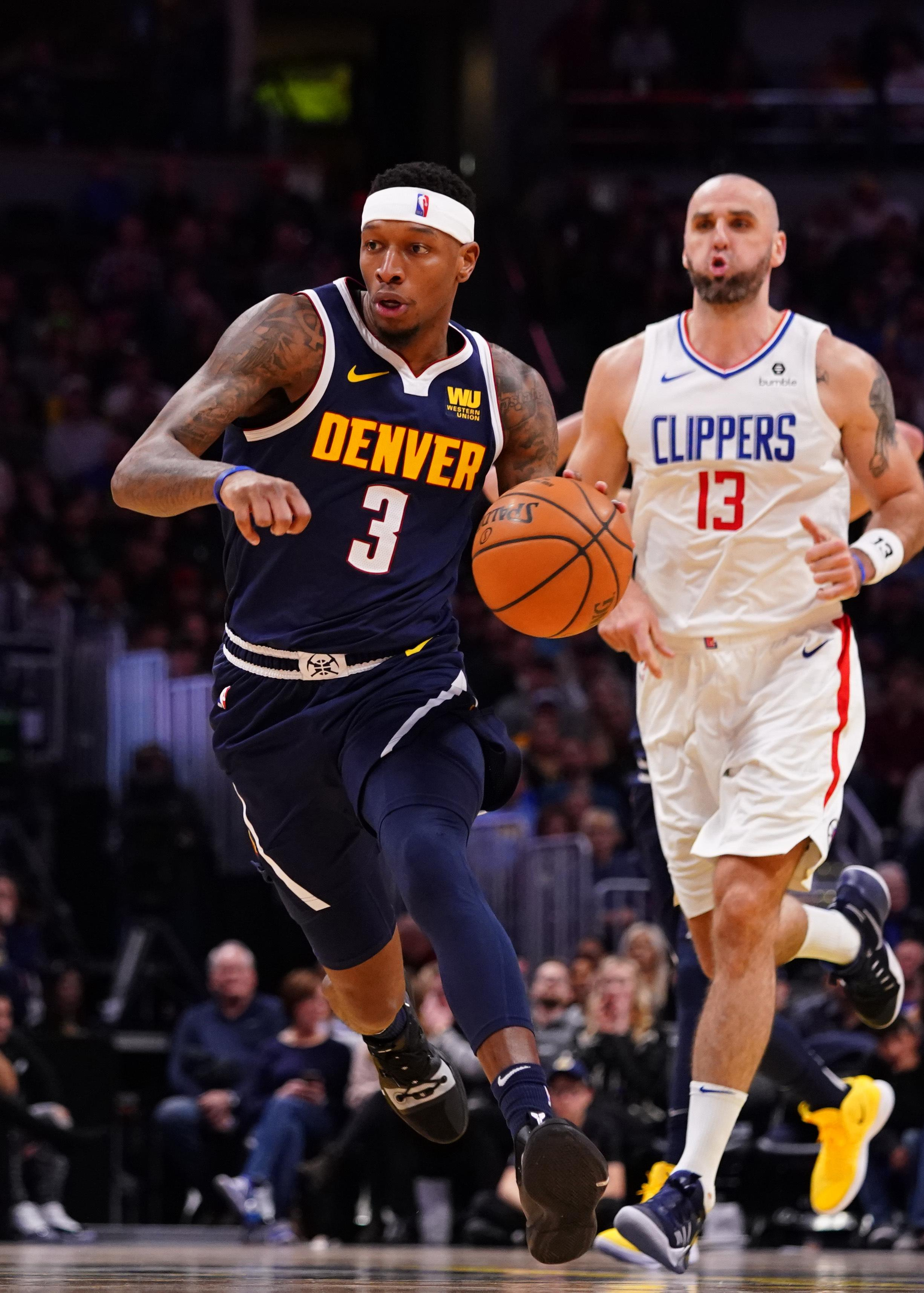 big sale d922f 968e8 Denver Nuggets guard Torrey Craig drives the court against the Los Angeles  Clippers during the third