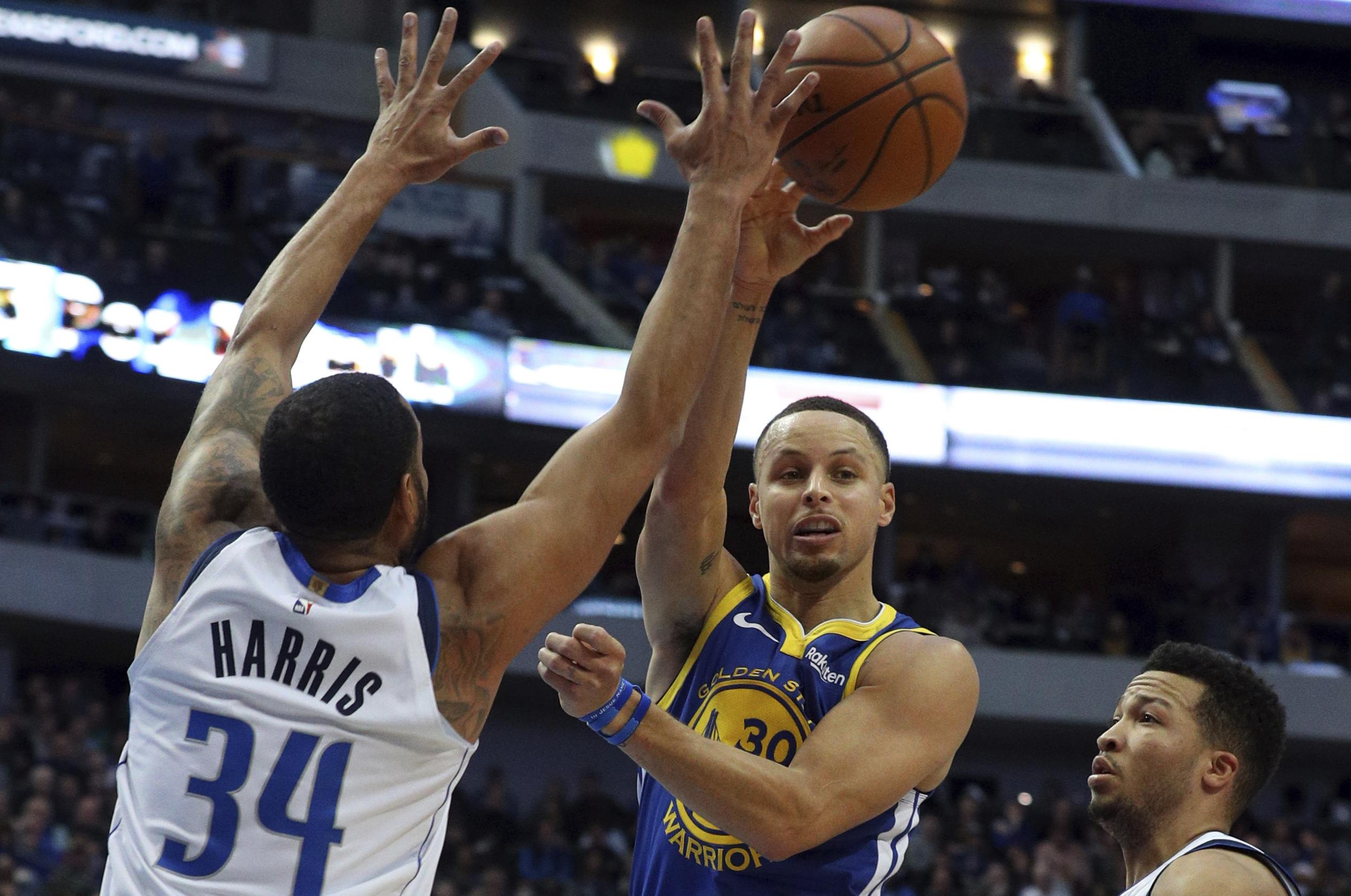 cb7824f6c25 Golden State Warriors guard Stephen Curry (30) passes the ball around  Dallas Mavericks guard