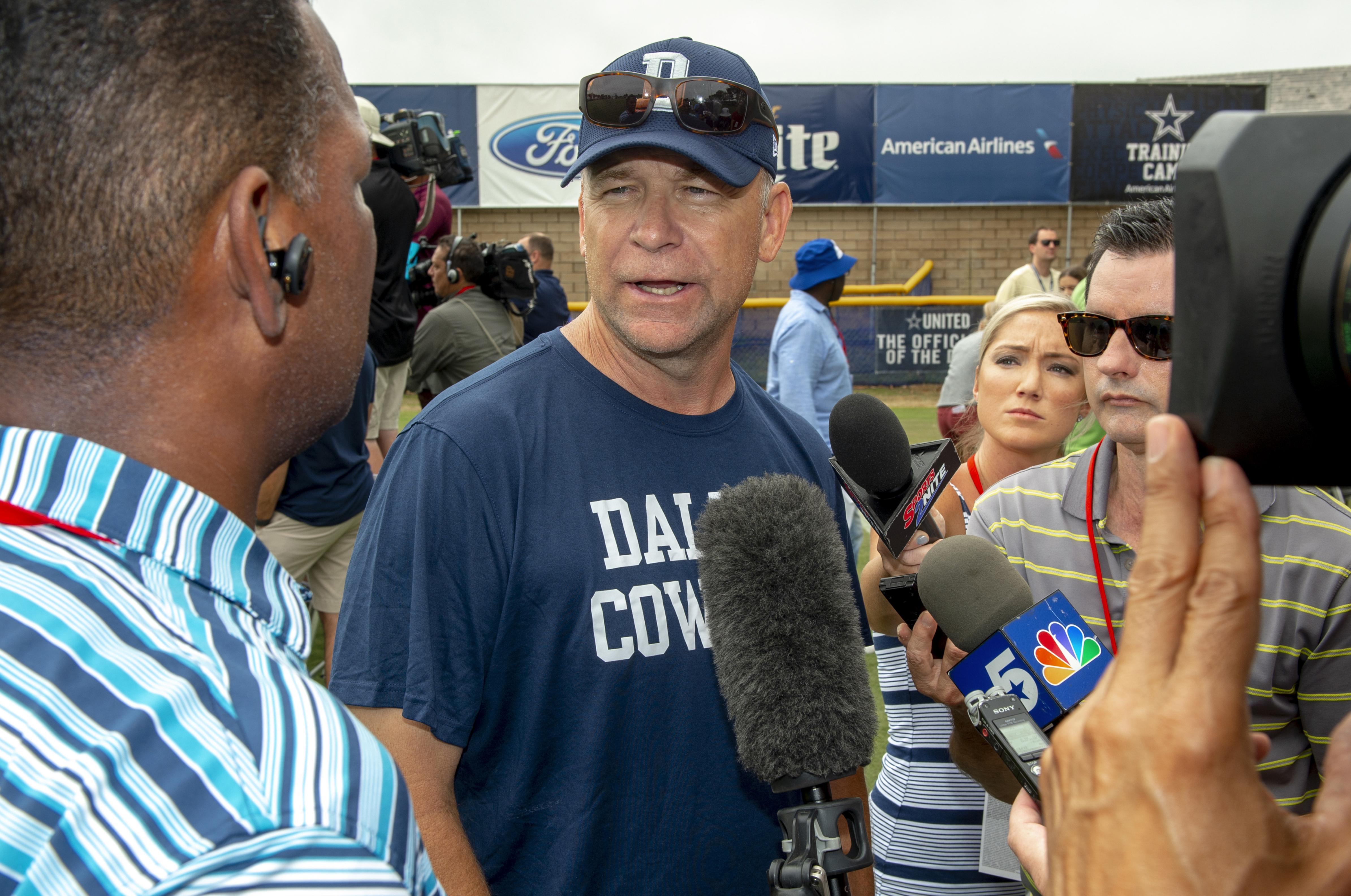1a8866115cb Dallas Cowboys offensive coordinator Scott Linehan talks with the media  after a July football training camp