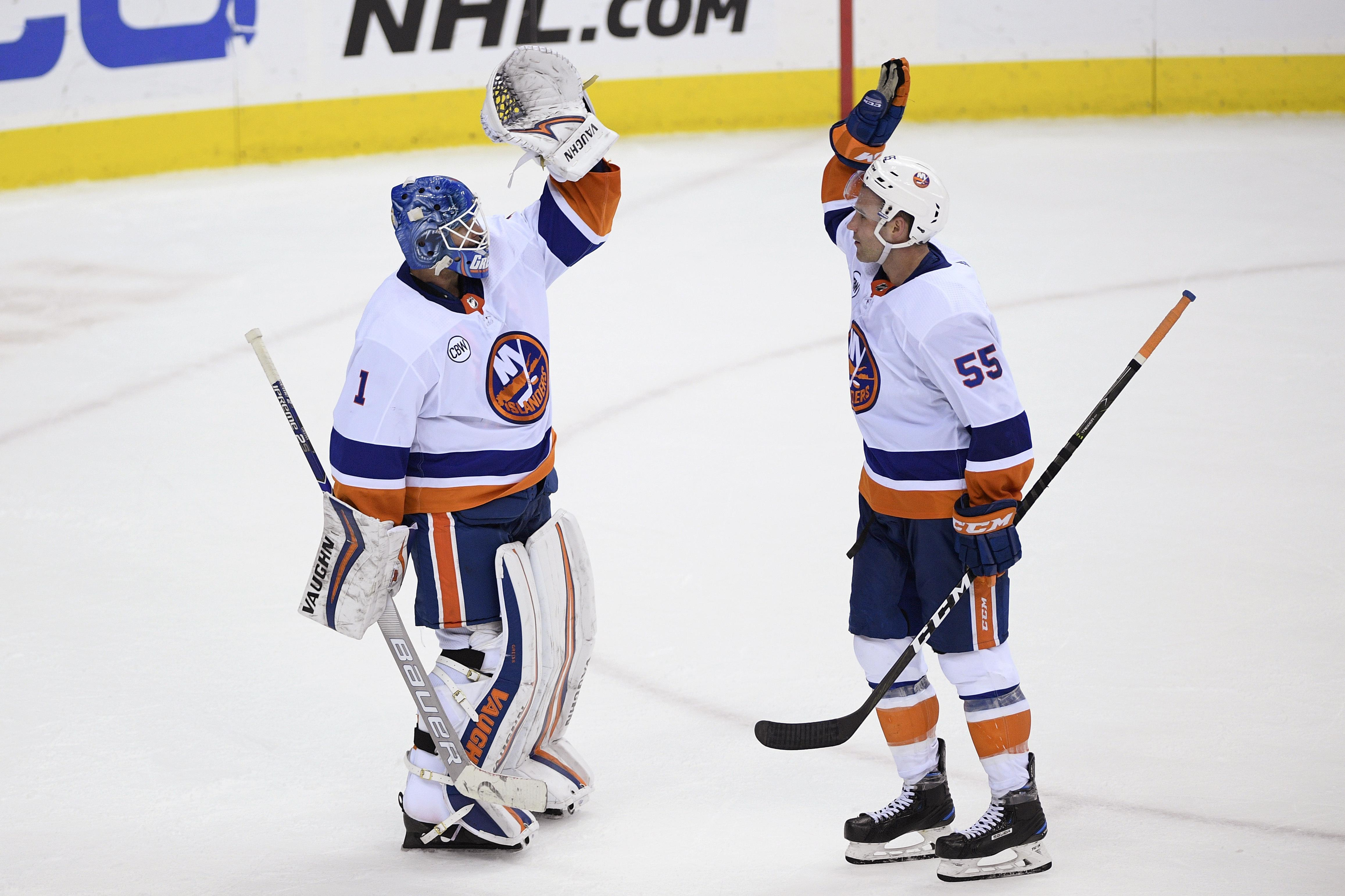 c9faabf5f3a New York Islanders goaltender Thomas Greiss (1) celebrates with defenseman  Johnny Boychuk (55