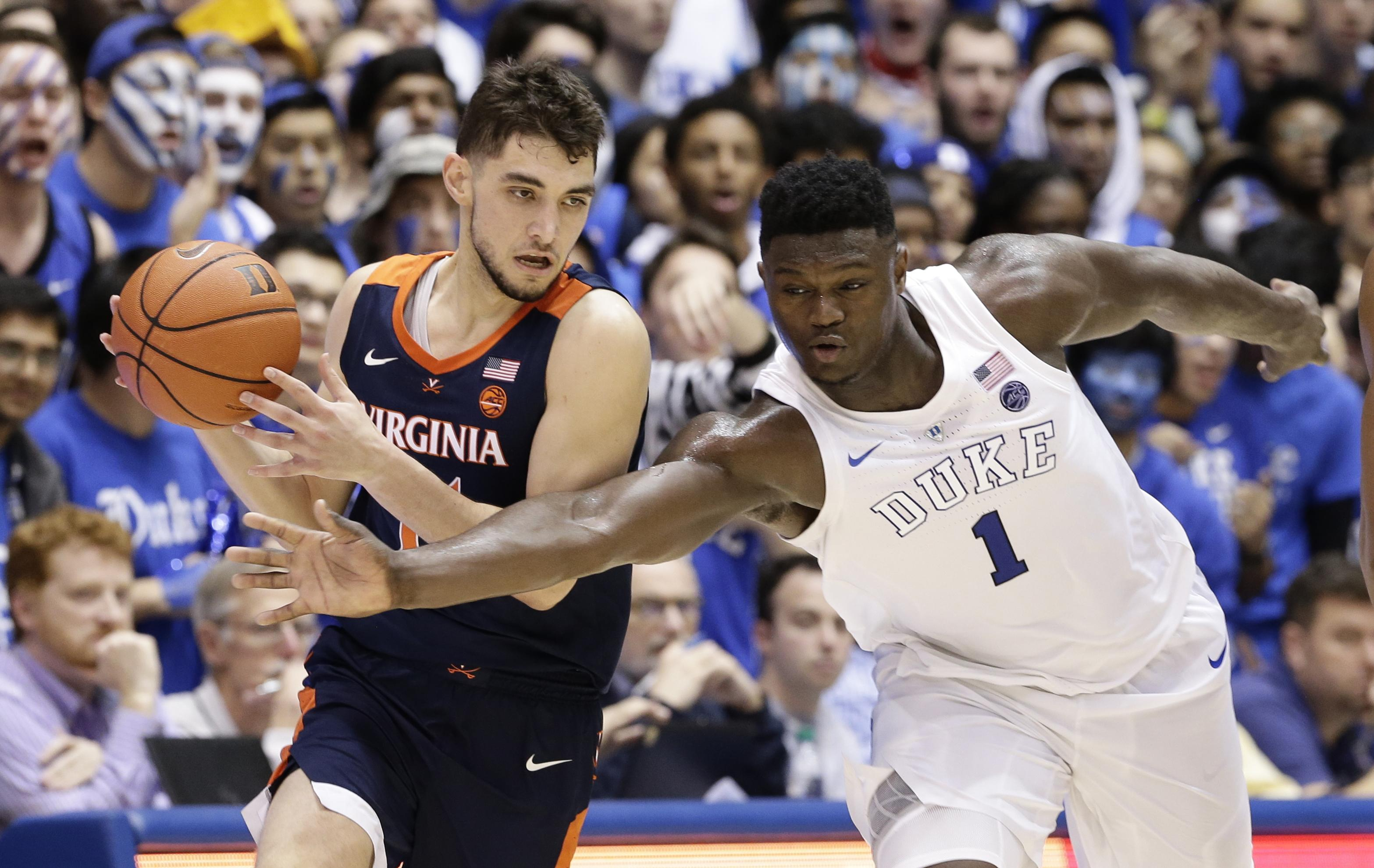 e28240a6c676 Duke s Zion Williamson reaches to steal the ball from Virginia s Ty Jerome  during the second half