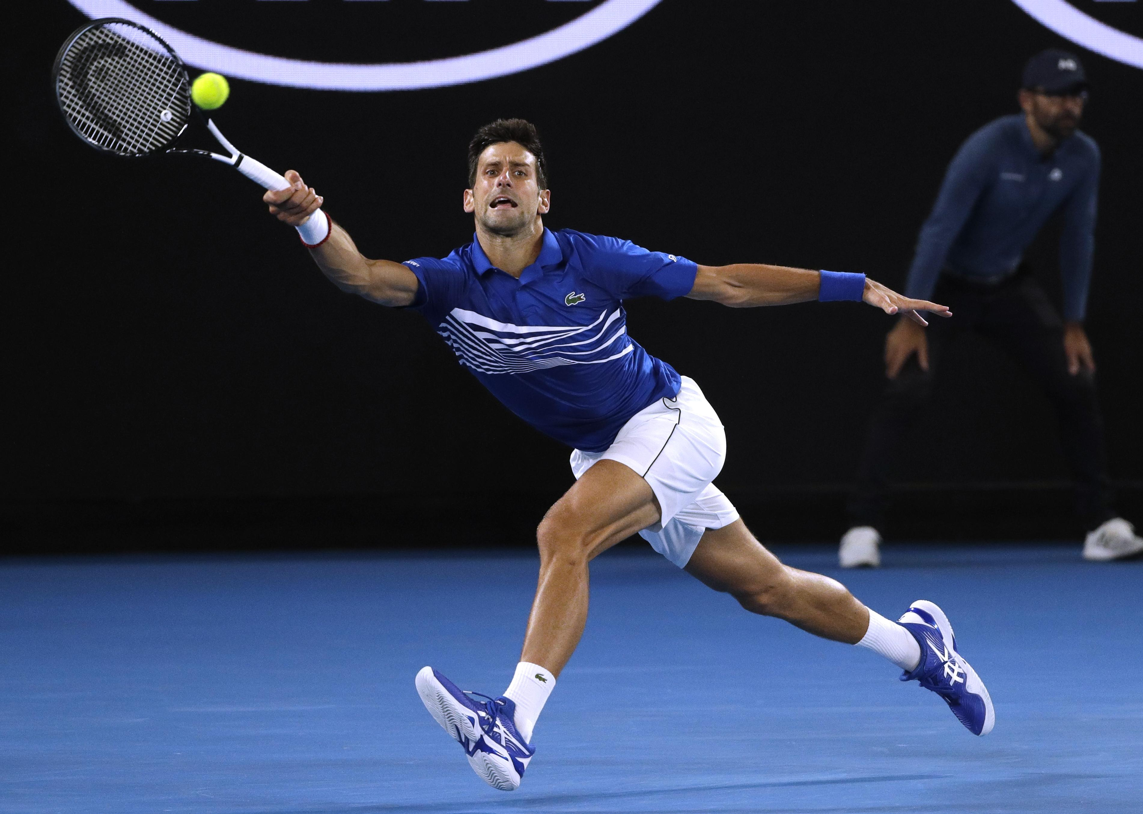 13cb3d2535d5 Serbia s Novak Djokovic makes a forehand return to France s Lucas Pouille  during their semifinal at the