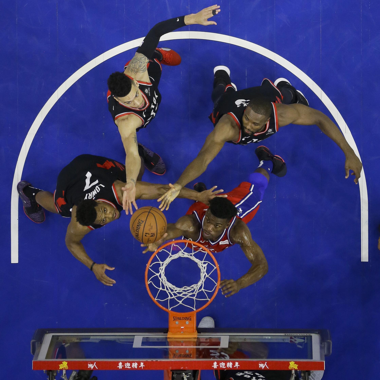 14d3877b584 Philadelphia 76ers' Jimmy Butler, bottom right, battles for a rebound with  Toronto Raptors
