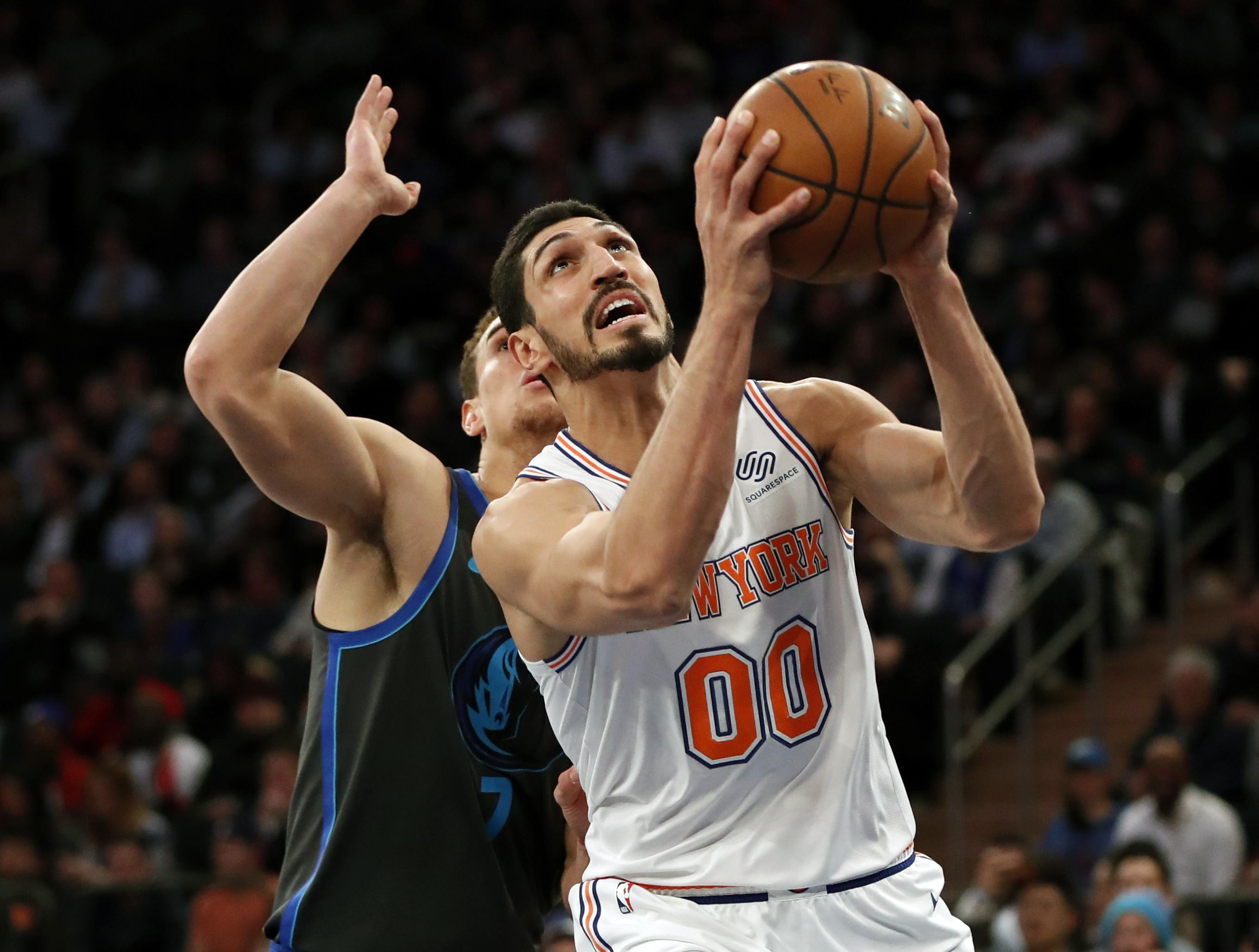 f747376b681 Dallas Mavericks forward Dwight Powell (7) defends New York Knicks center Enes  Kanter (