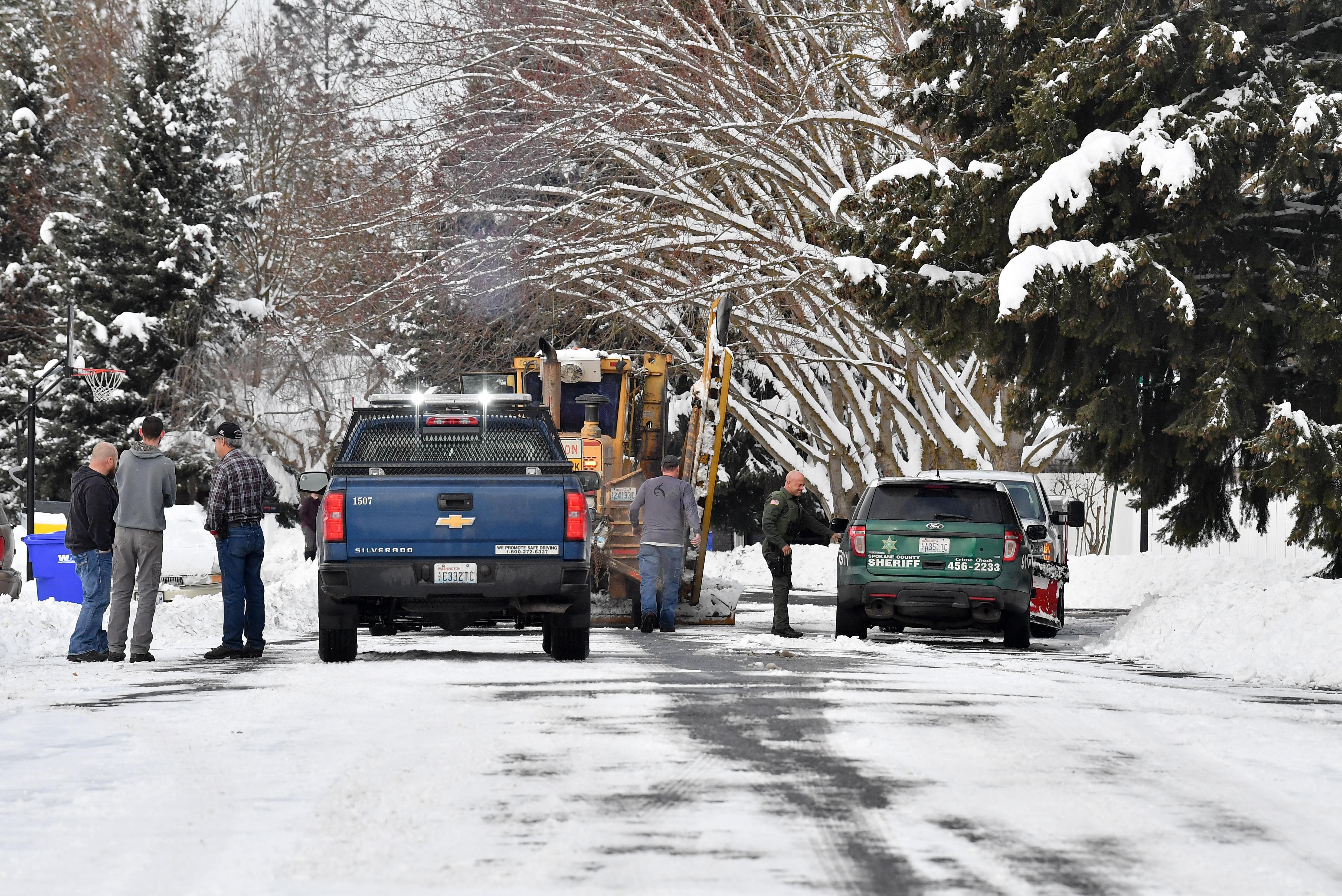 Two balck men plowing outdoor