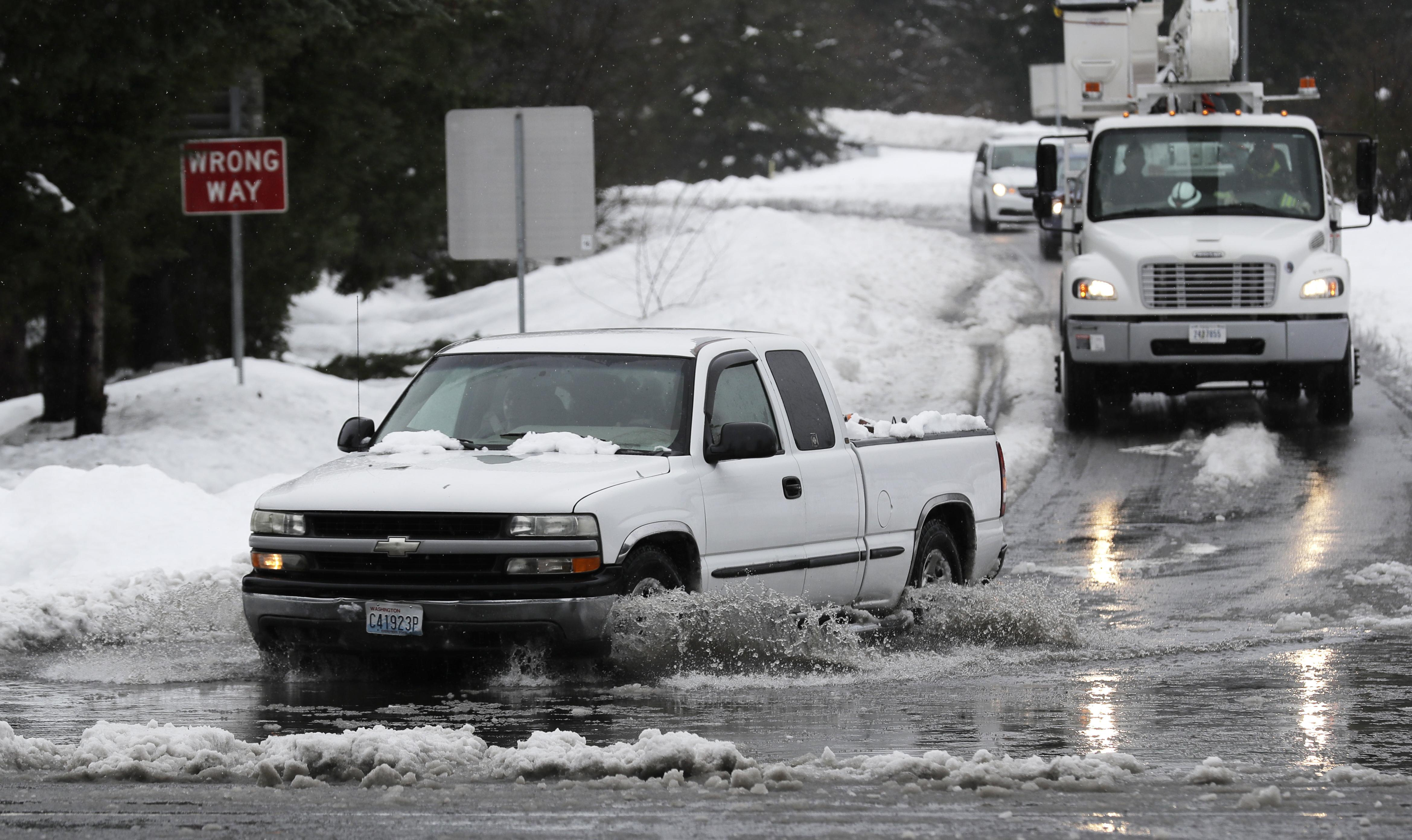 Road closures, flooding in Northwest due to rain, snow | The
