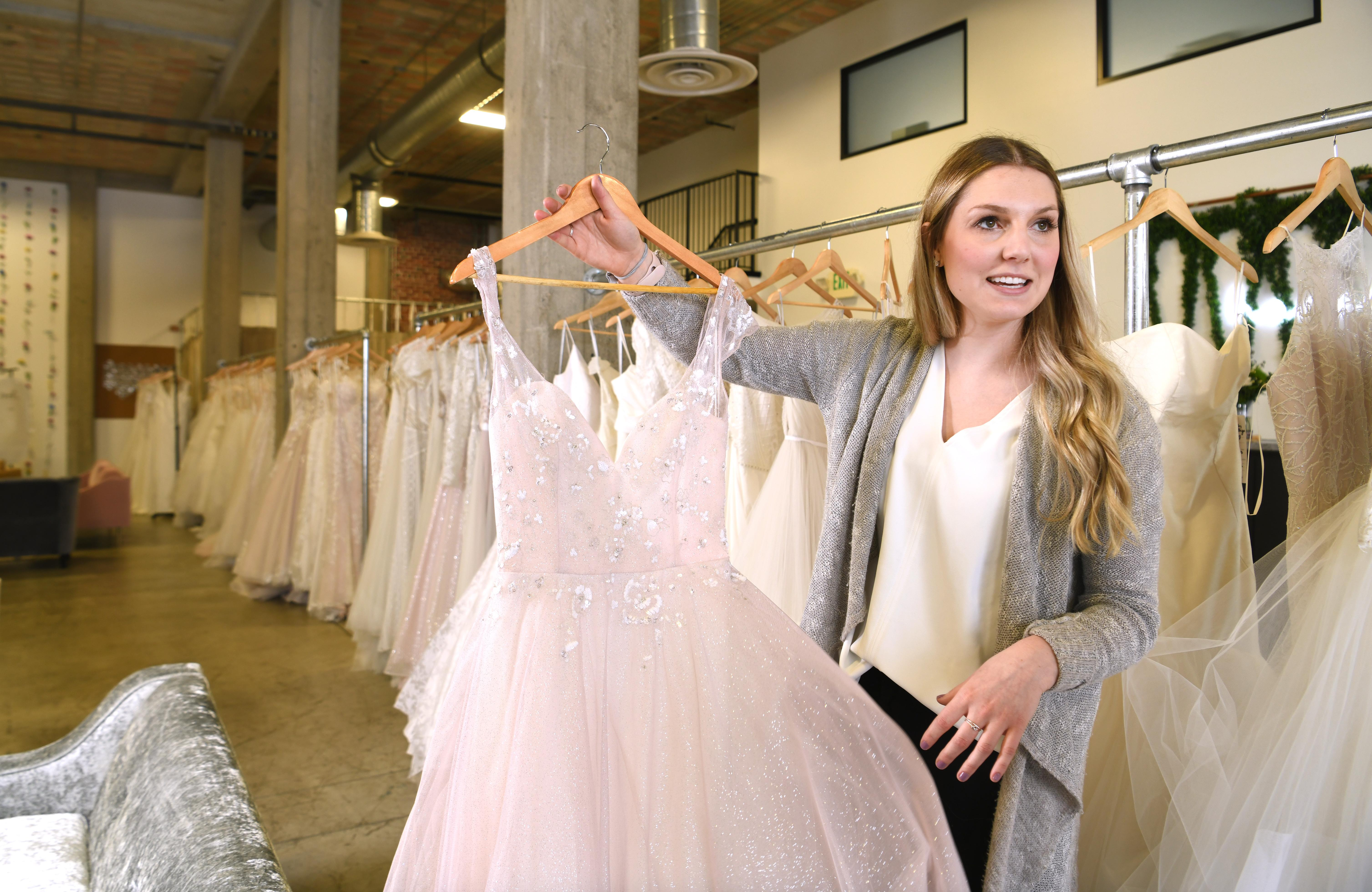 03e4be981c421 Cassie David shows off a Hayley Paige wedding dress in her bridal shop,  Honest in