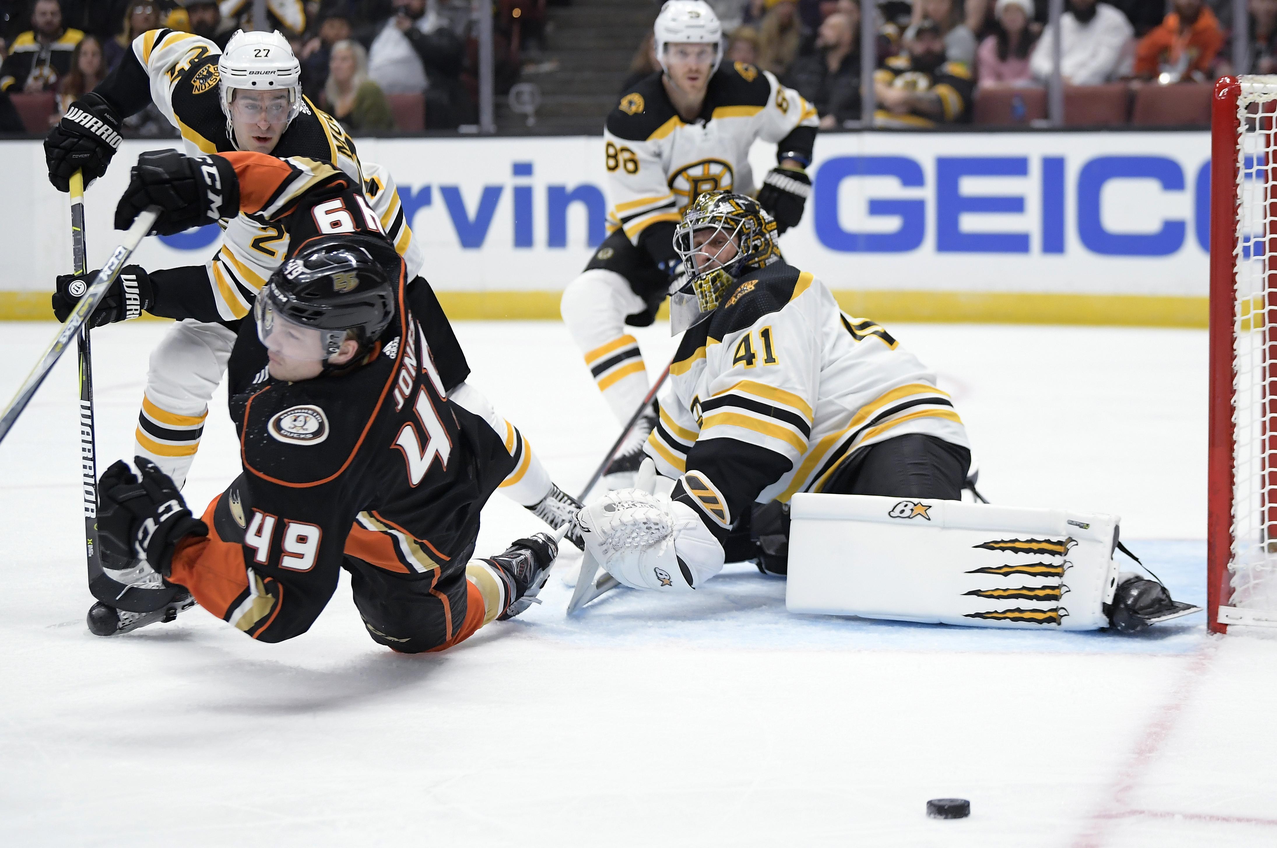 a6848bdf2 Boston Bruins goaltender Jaroslav Halak, right, deflects a shot as Anaheim  Ducks left wing