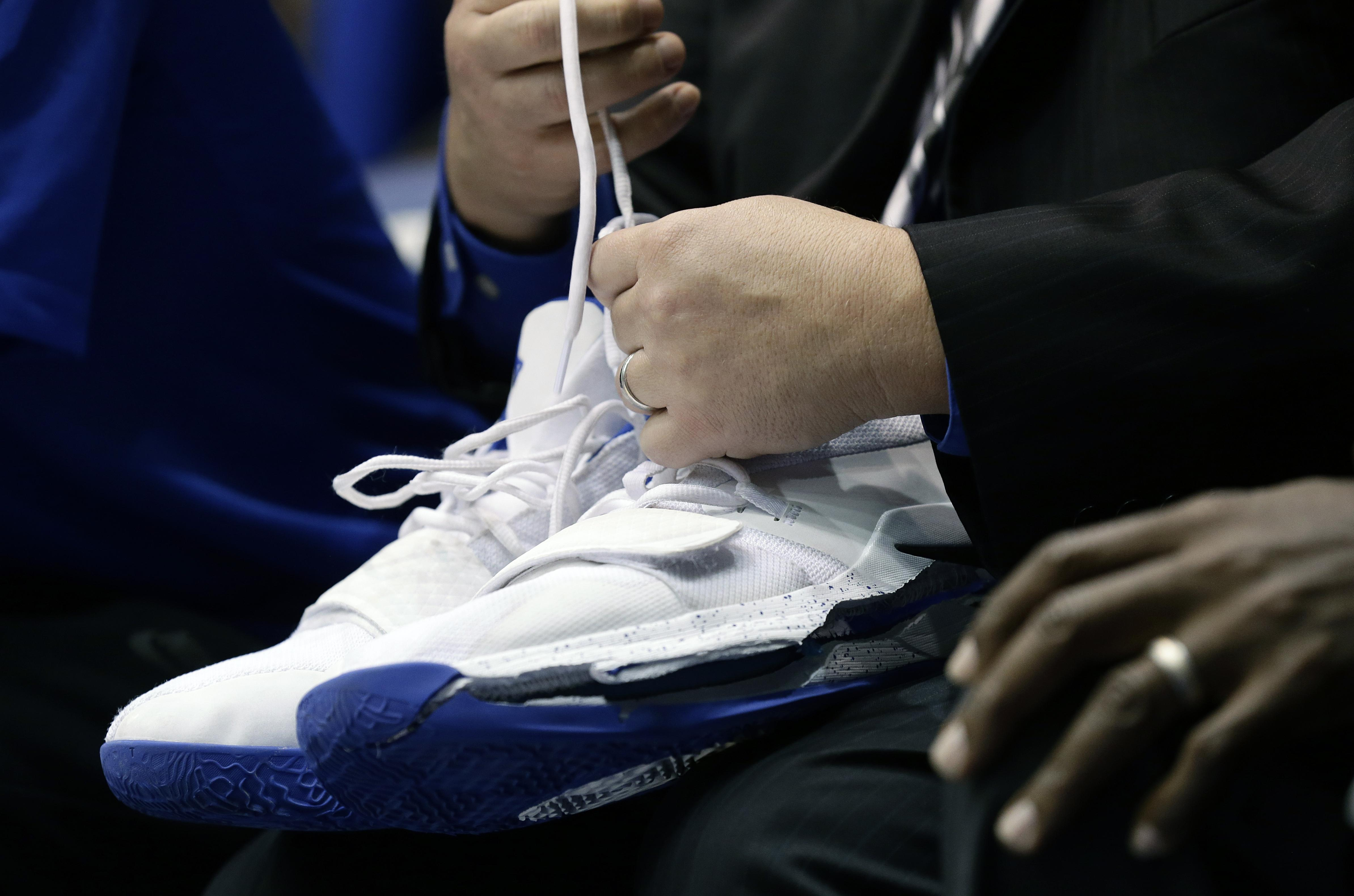 c4927421668 A trainer holds Duke s Zion Williamson s shoes after Williamson left the  game due to an injury
