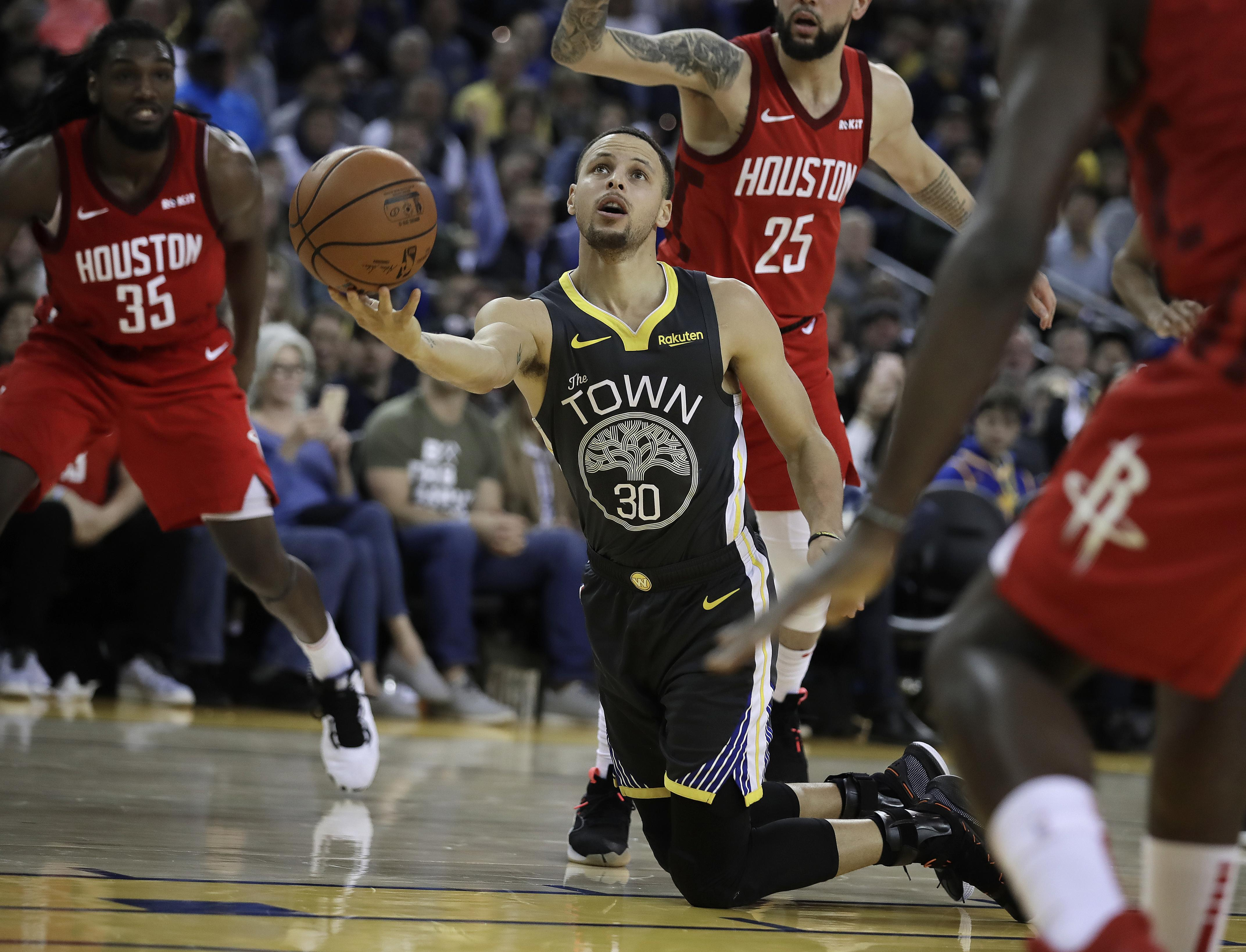 995562bd8ad Golden State Warriors  Stephen Curry (30) shoots from his knees against  Houston on