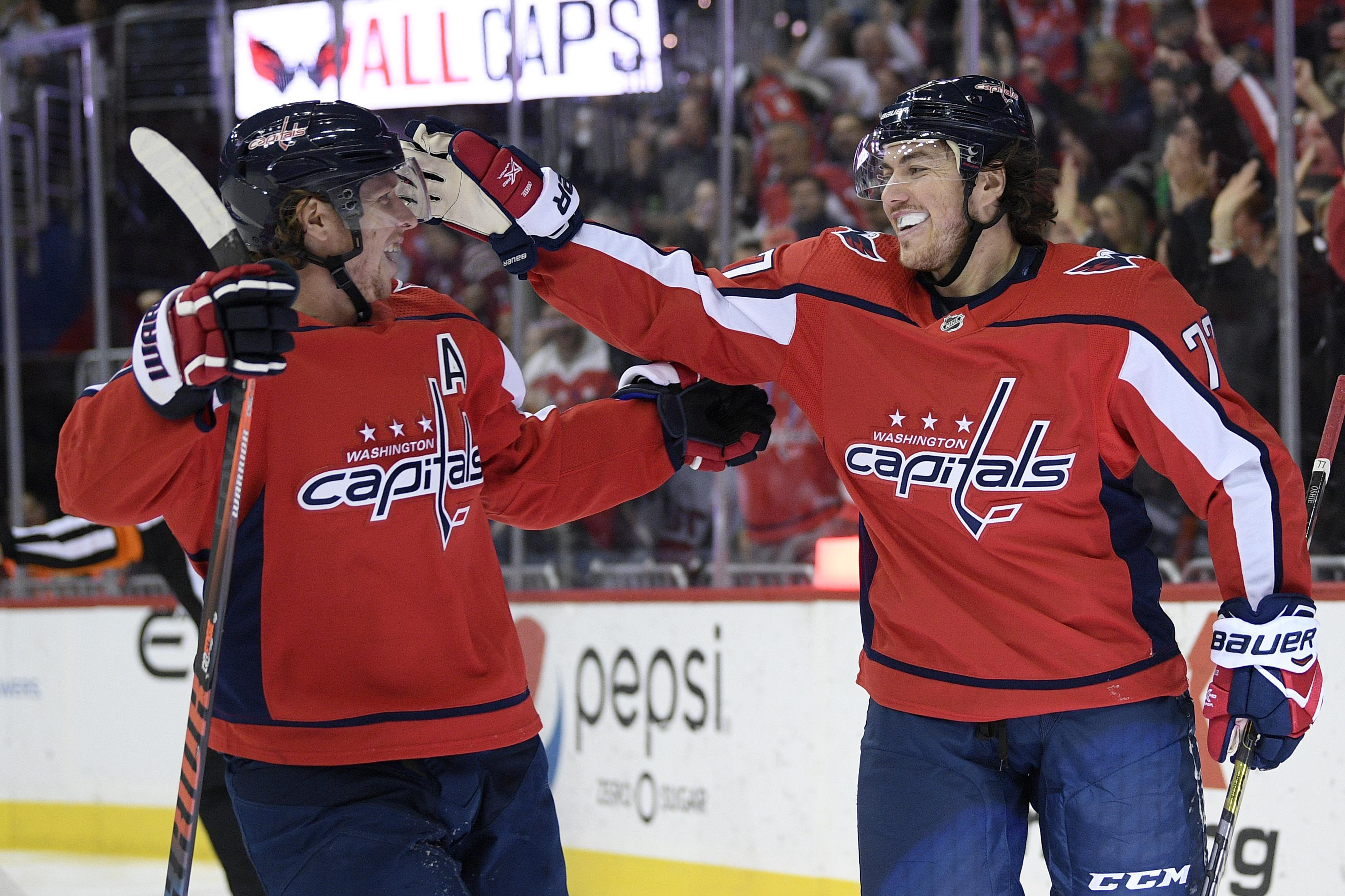 f638d6f5a4a Washington Capitals right wing T.J. Oshie (77) celebrates his goal with  center Nicklas Backstrom