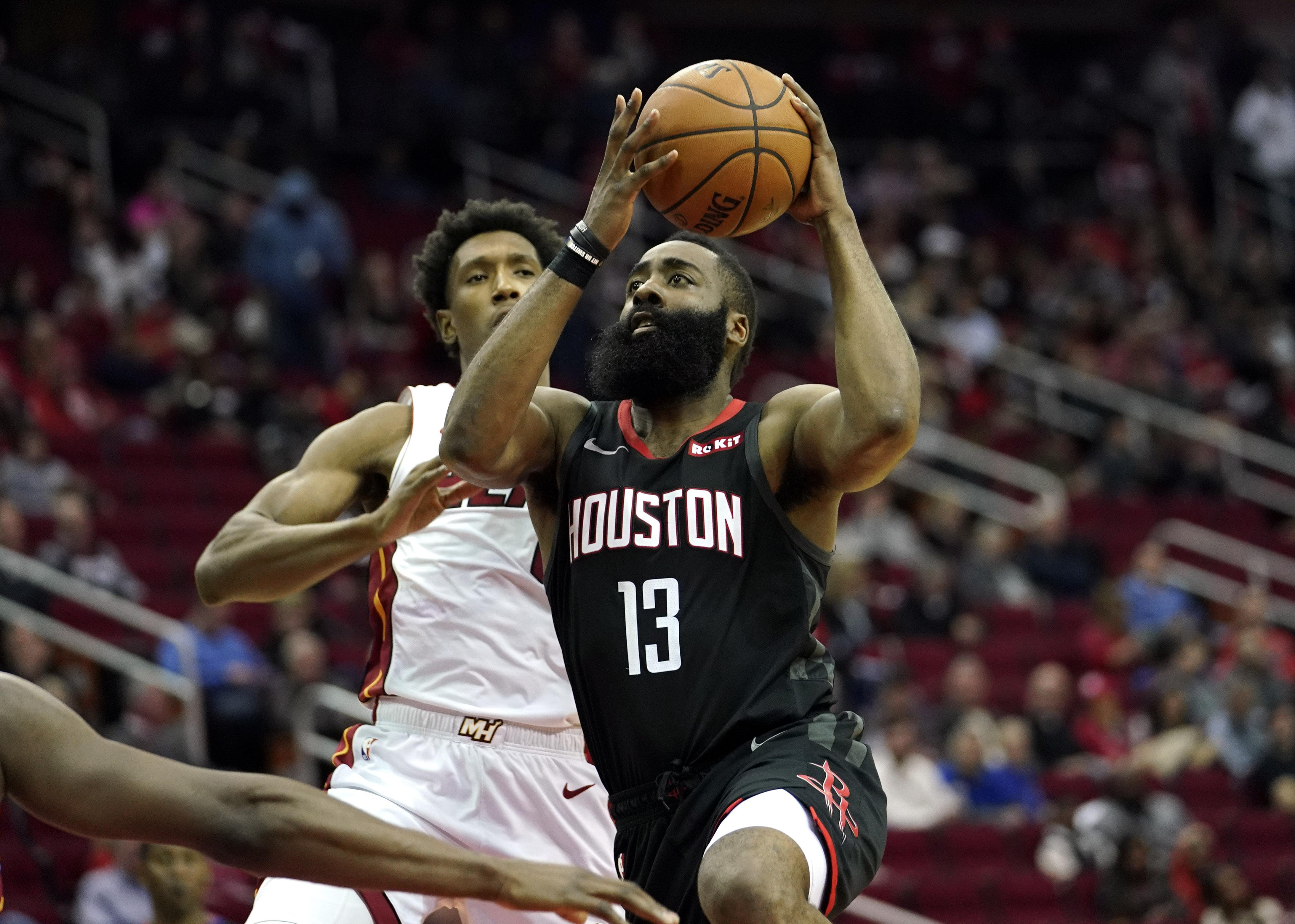 6eae32019f9b Houston Rockets  James Harden (13) goes up for a shot as Miami Heat s