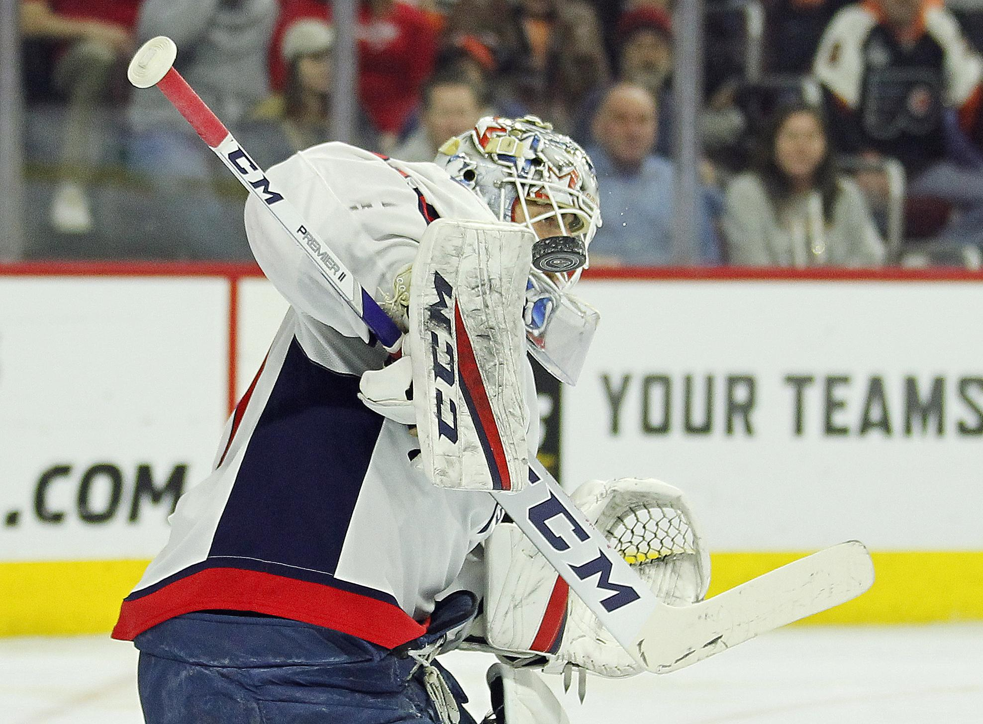 6fbf5990350 Washington Capitals  Braden Holtby deflects the puck with his board during  the second period of