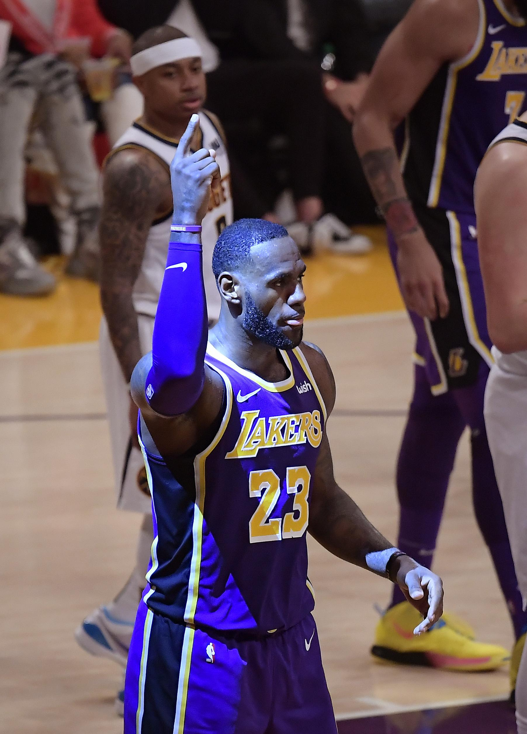 4d0ac146d6e Los Angeles Lakers forward LeBron James gestures after scoring during the  first half of the team s