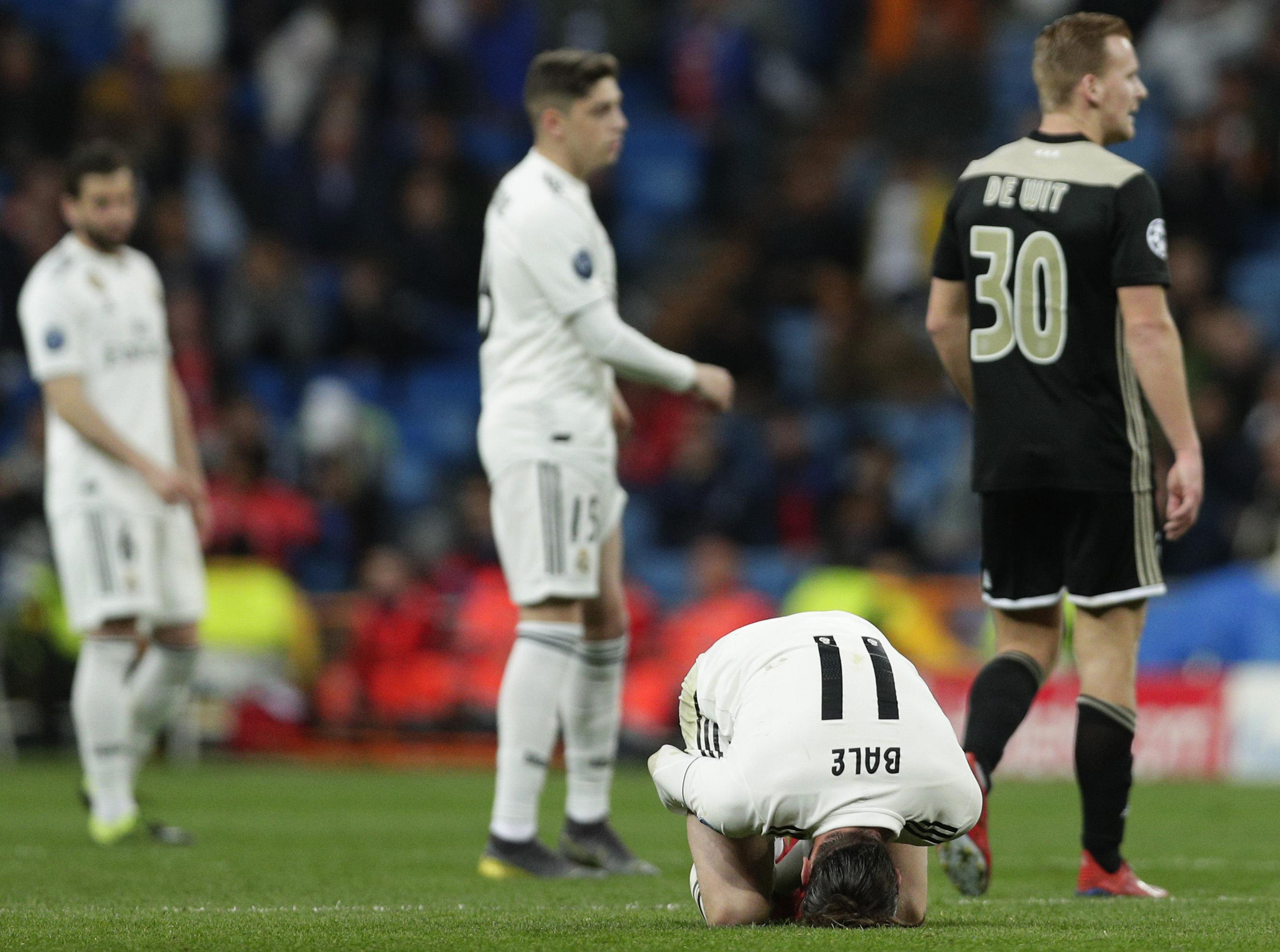 494e94ec374 Real midfielder Gareth Bale reacts on the ground during the Champions  League soccer match between Real