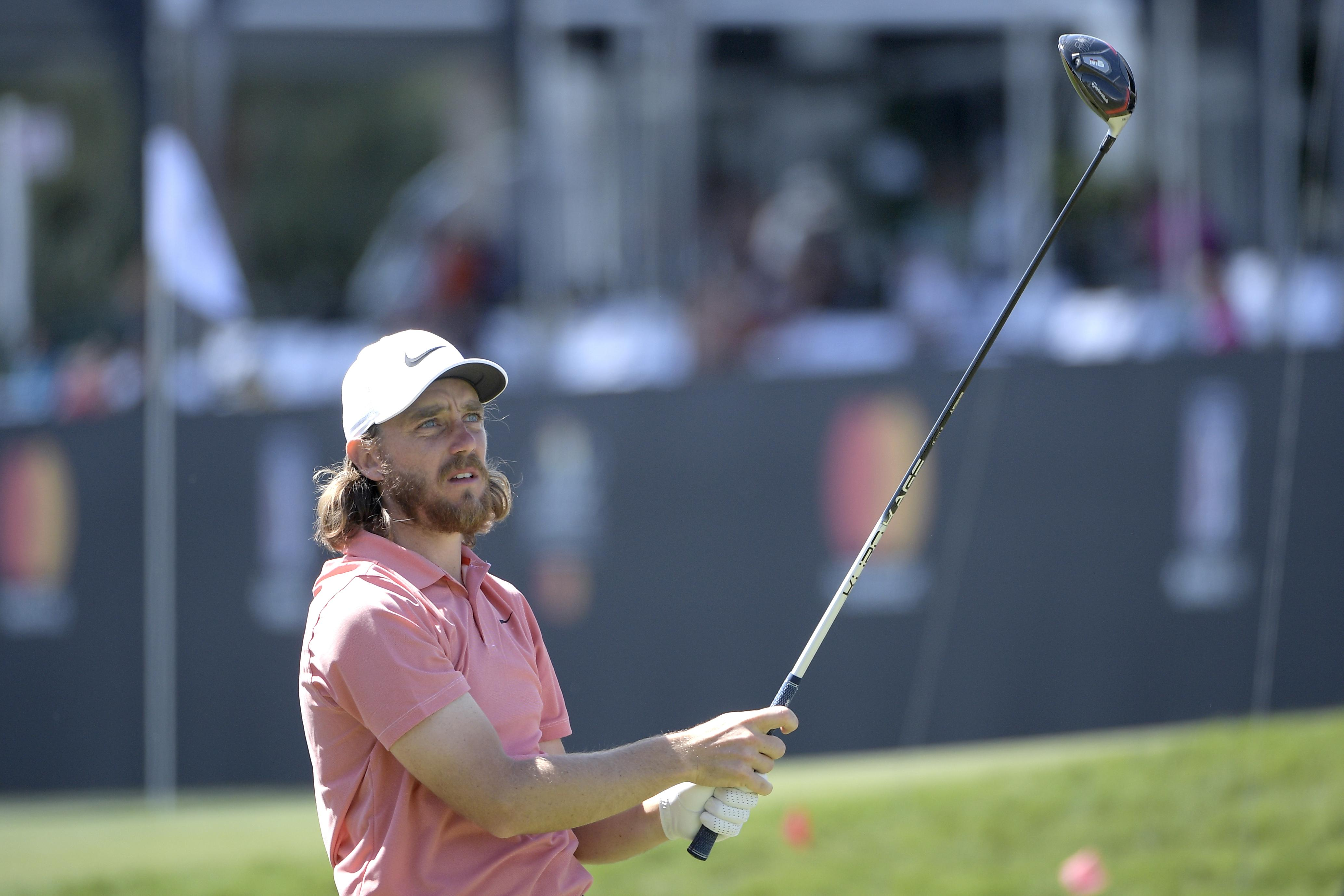 Tommy Fleetwood, of England, watches his tee shot on the 18th hole during the