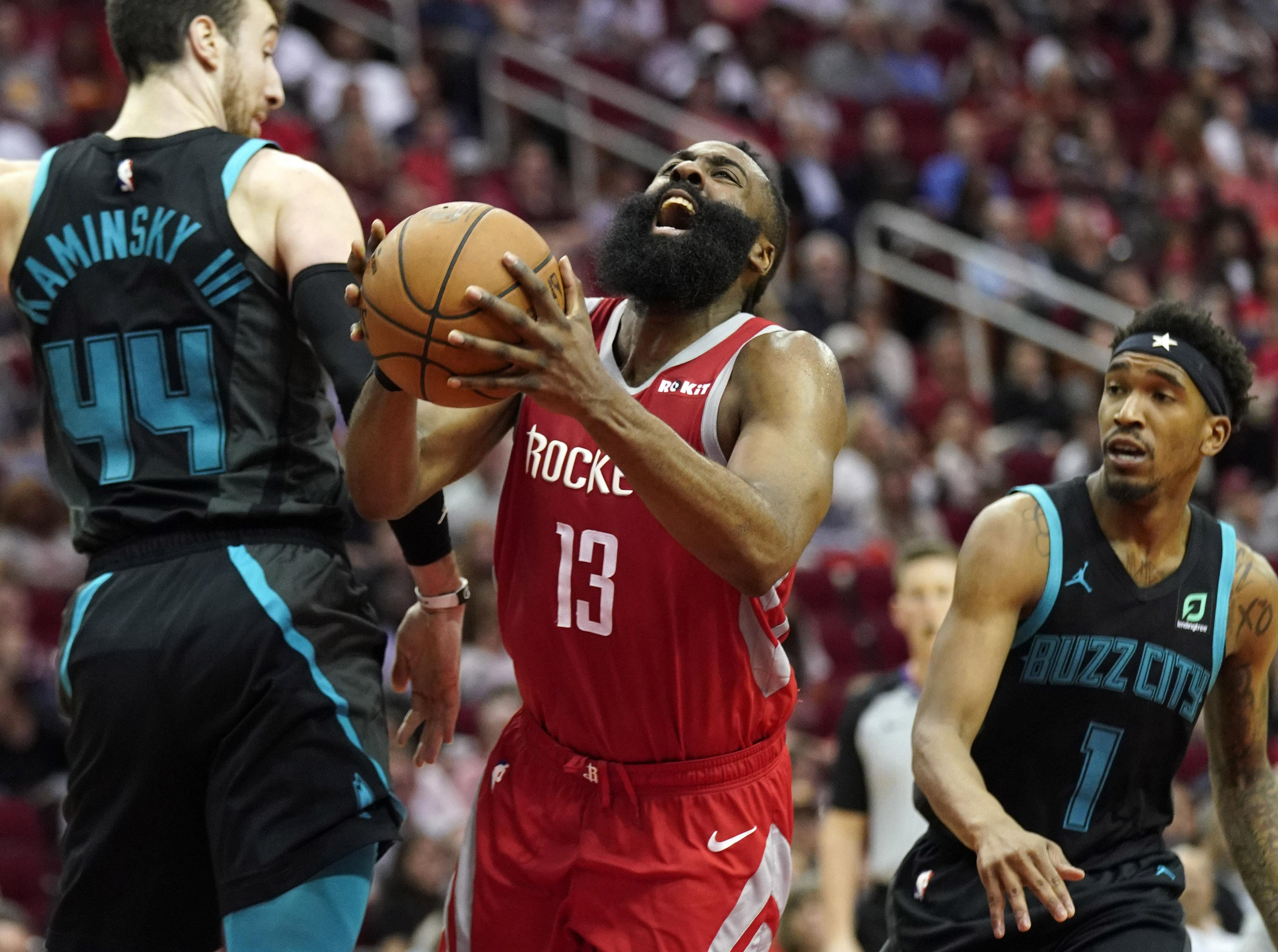 d85b35b8507d Houston s James Harden (13) shoots after being fouled by Charlotte Hornets   Malik Monk