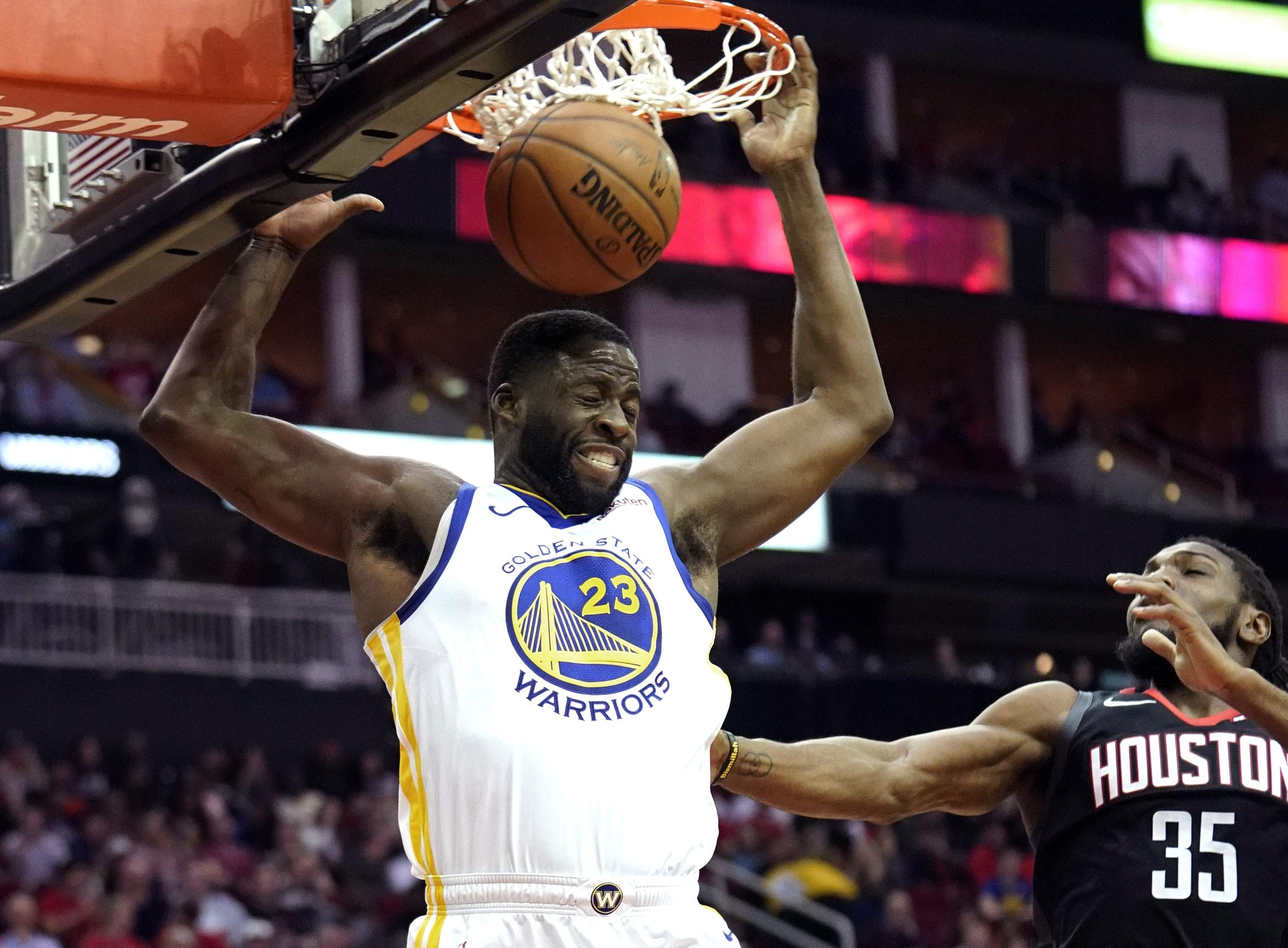afc1d61a034b Golden State s Draymond Green (23) dunks as Houston s Kenneth Faried (35)  defends