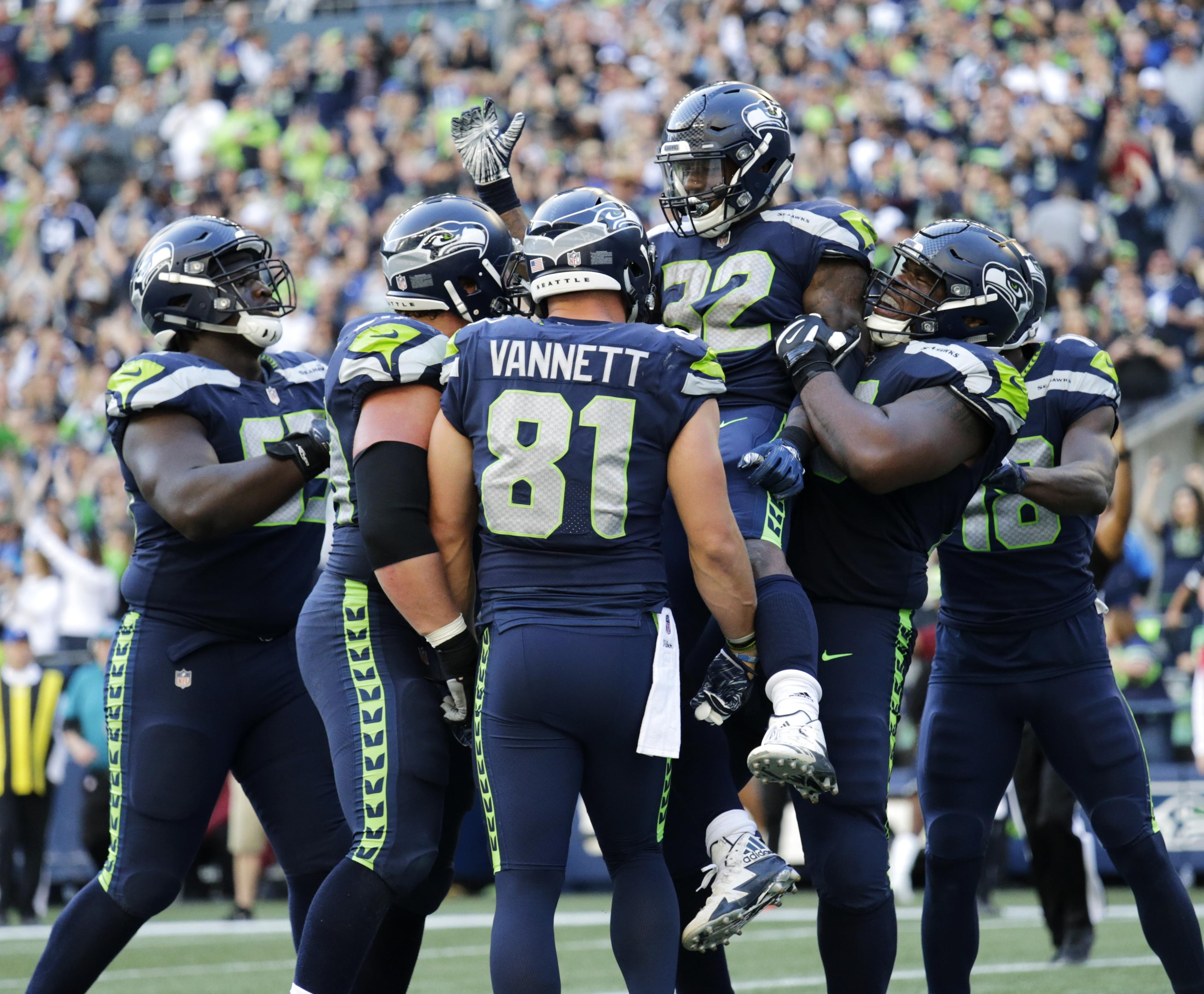 74c321914 Seattle Seahawks running back Chris Carson (32) is lifted by offensive  guard D.J. Fluker
