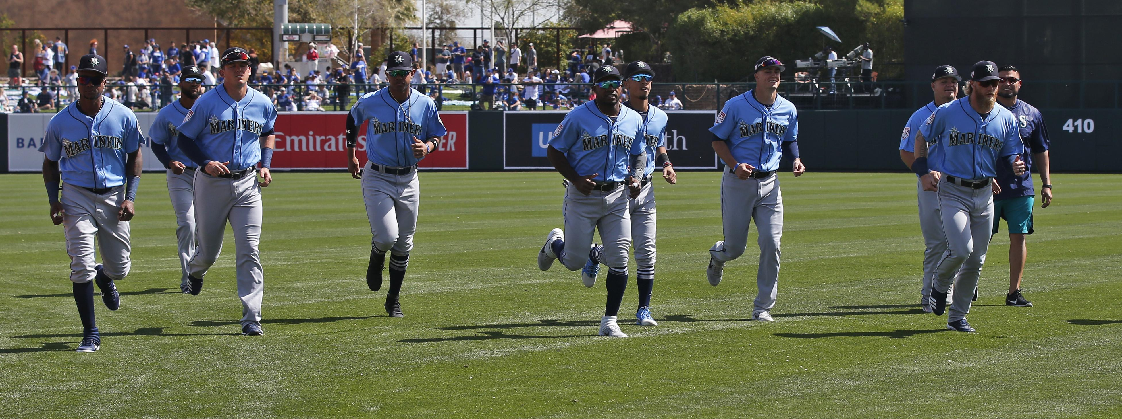 f59694347 Seattle Mariners jog in the outfield before a spring training game against  the Los Angeles Dodgers