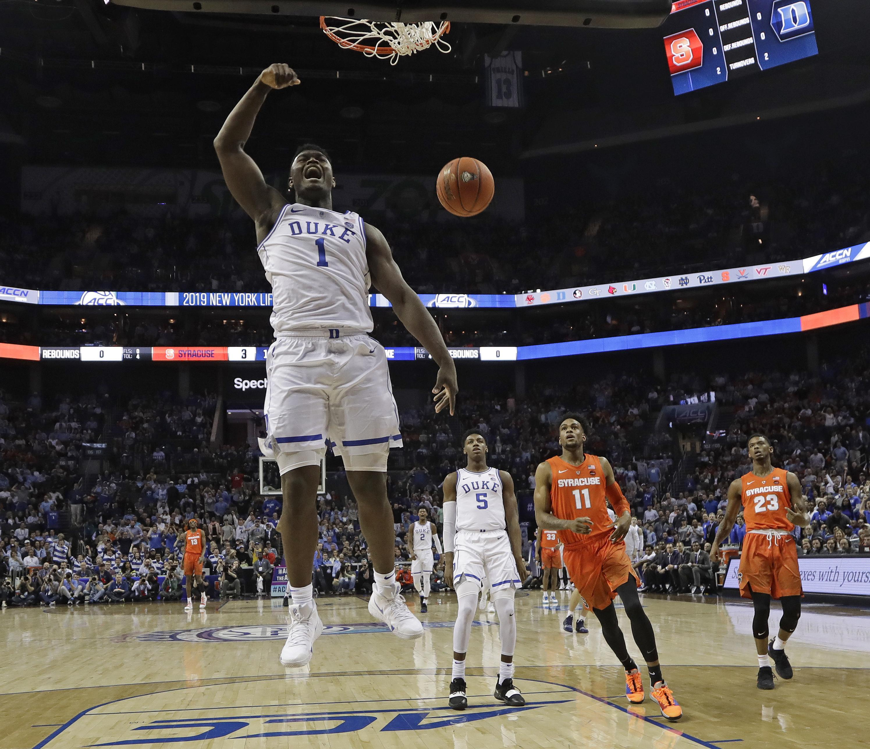 b4bfe0aea942 Duke s Zion Williamson (1) reacts after his dunk against Syracuse during  the first half