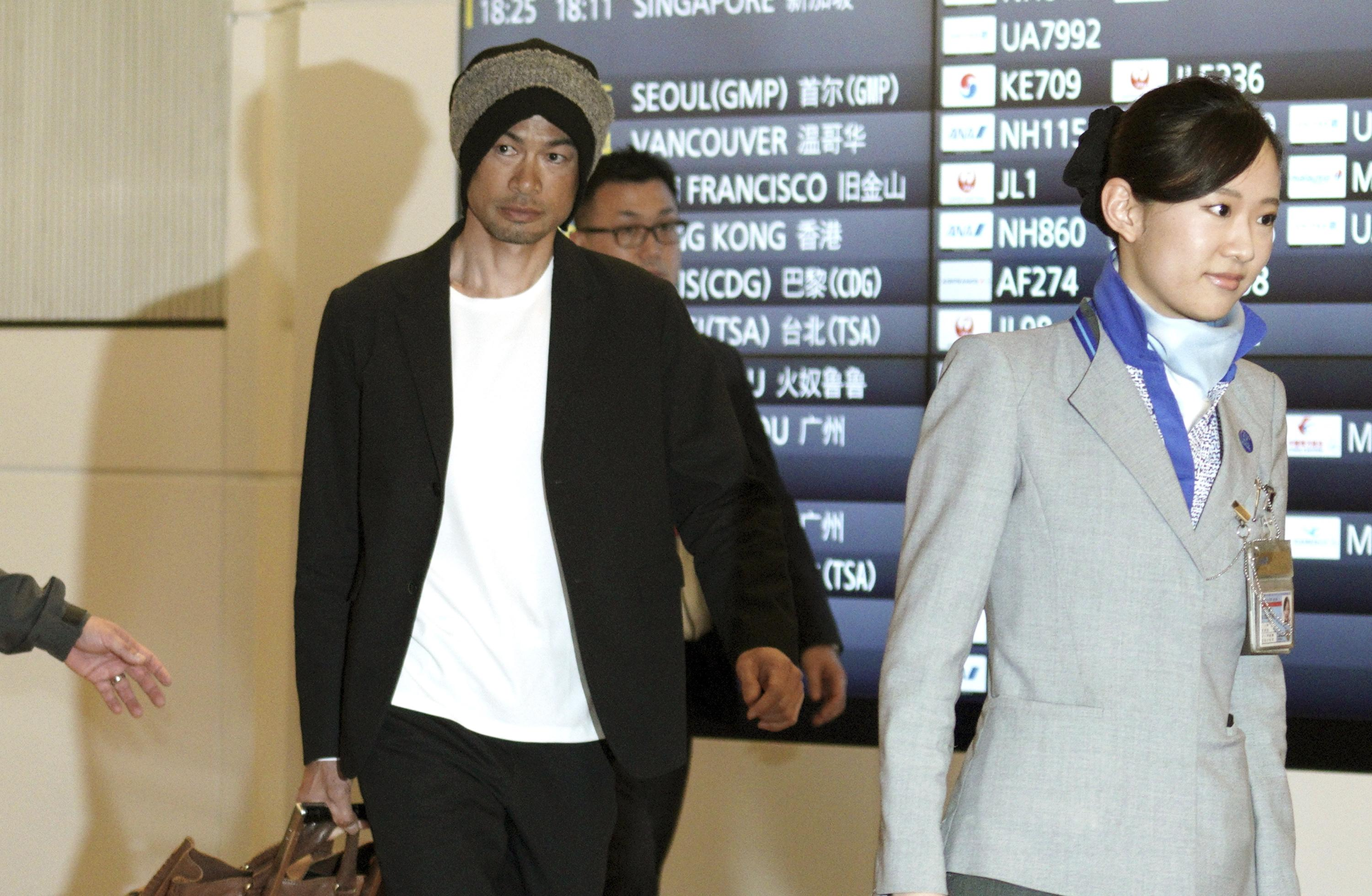 aaf3fb3491 Seattle s Ichiro Suzuki is escorted upon his team s arrival at Haneda  Airport in Tokyo on Friday