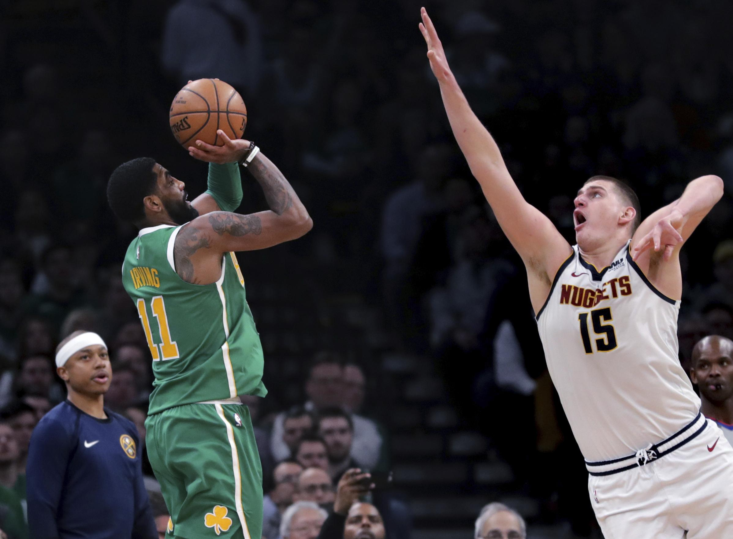 2795fd859fc Denver Nuggets center Nikola Jokic tries to block a shot by Boston Celtics  guard Kyrie Irving
