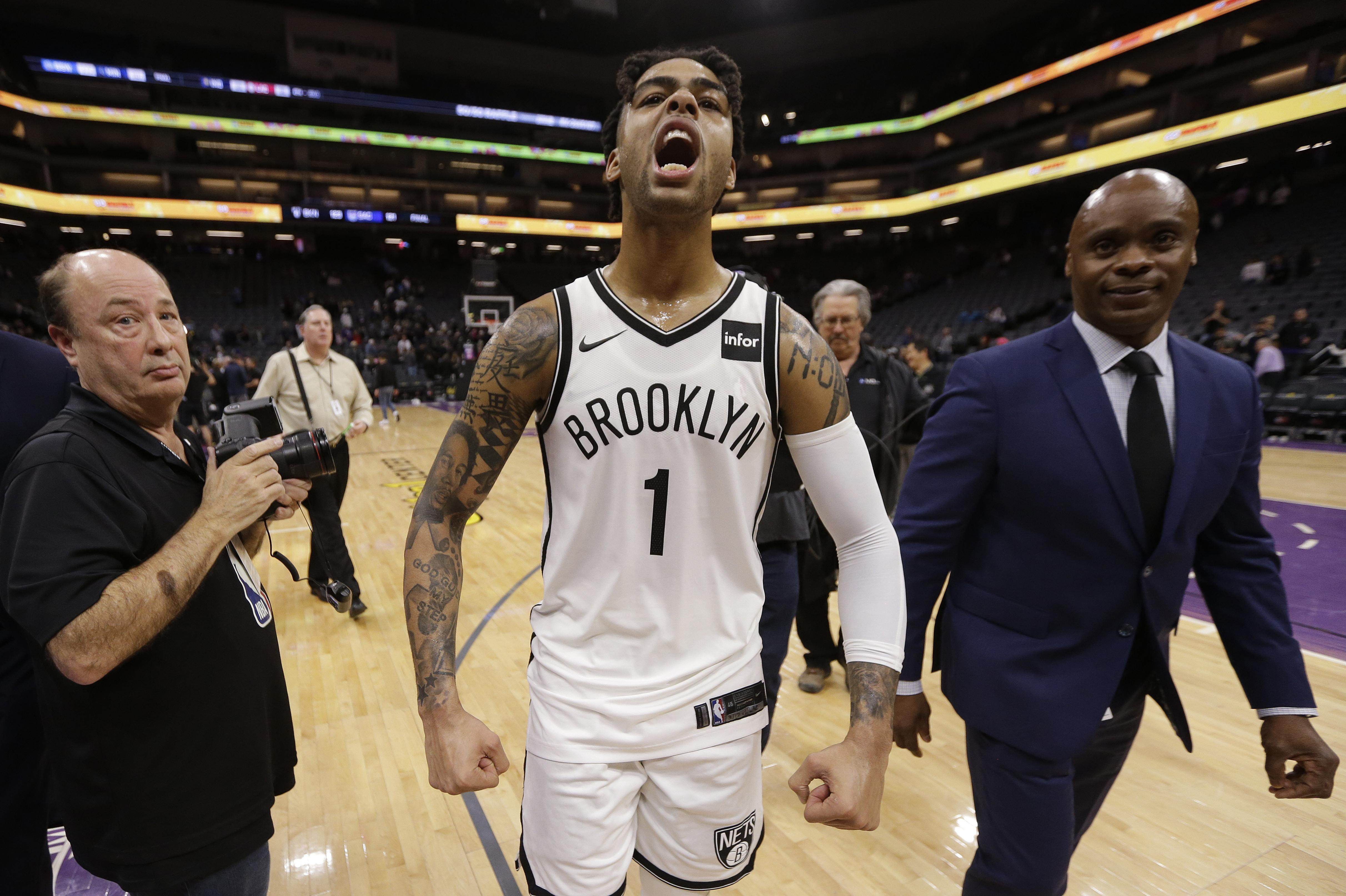 Brooklyn Nets guard D Angelo Russell celebrates as he walks off the court  after the 64da1843e