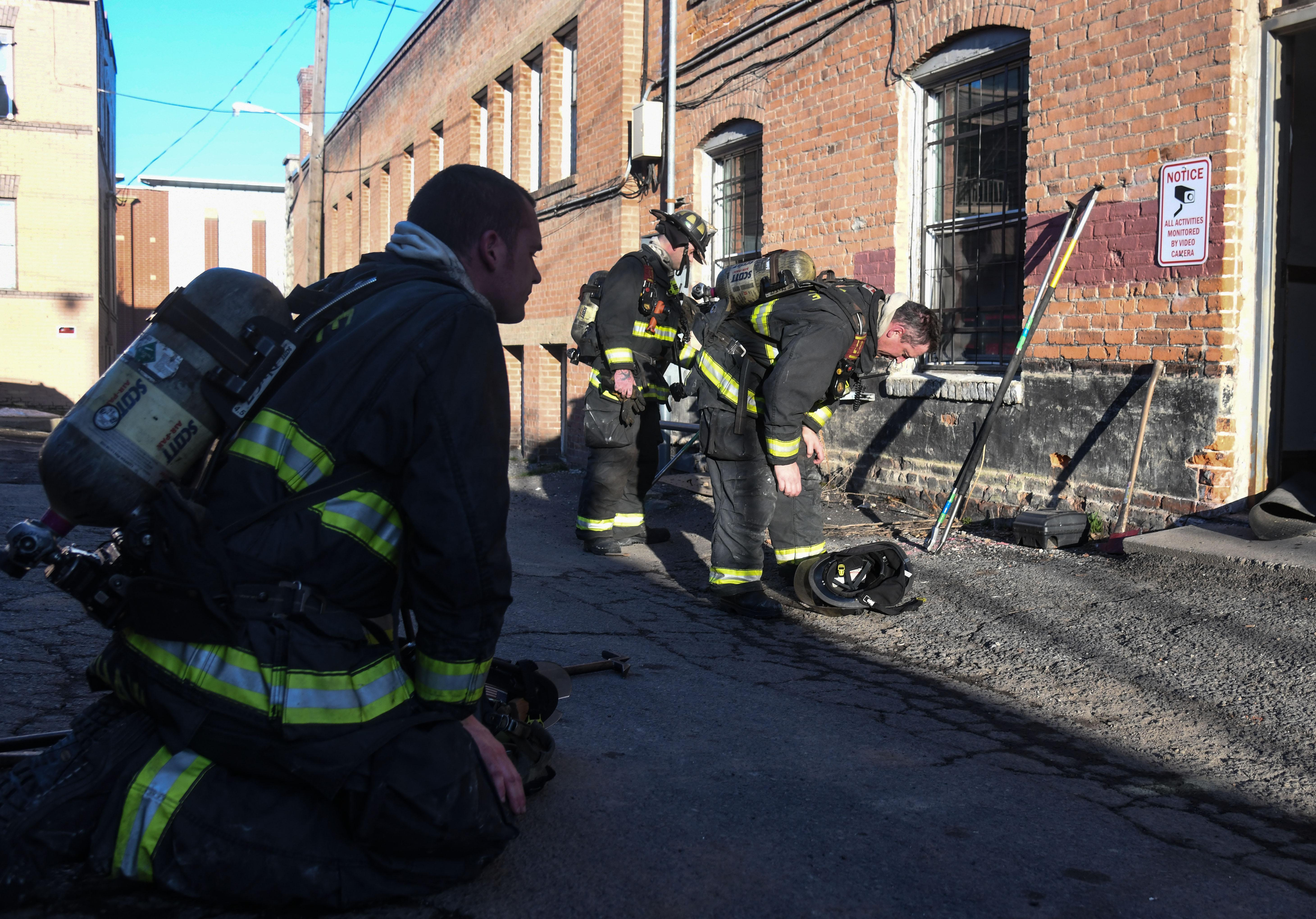 Spokane Fire Station 1 Ladder Firefighters Catch Their Breath In The Alley After Overhauling Rooms