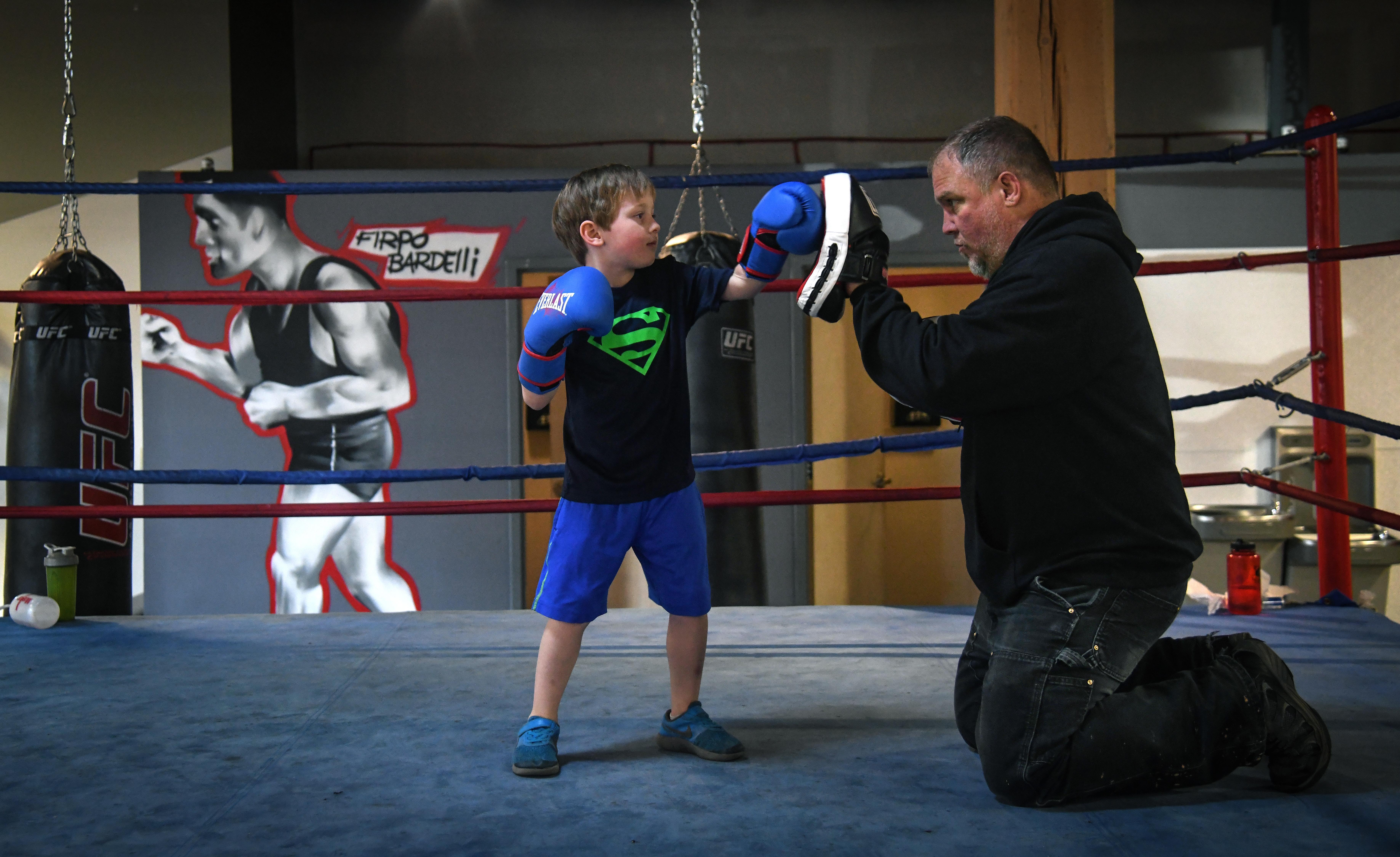 Year-round boxing, mentorship program puts Spokane police, gym owner