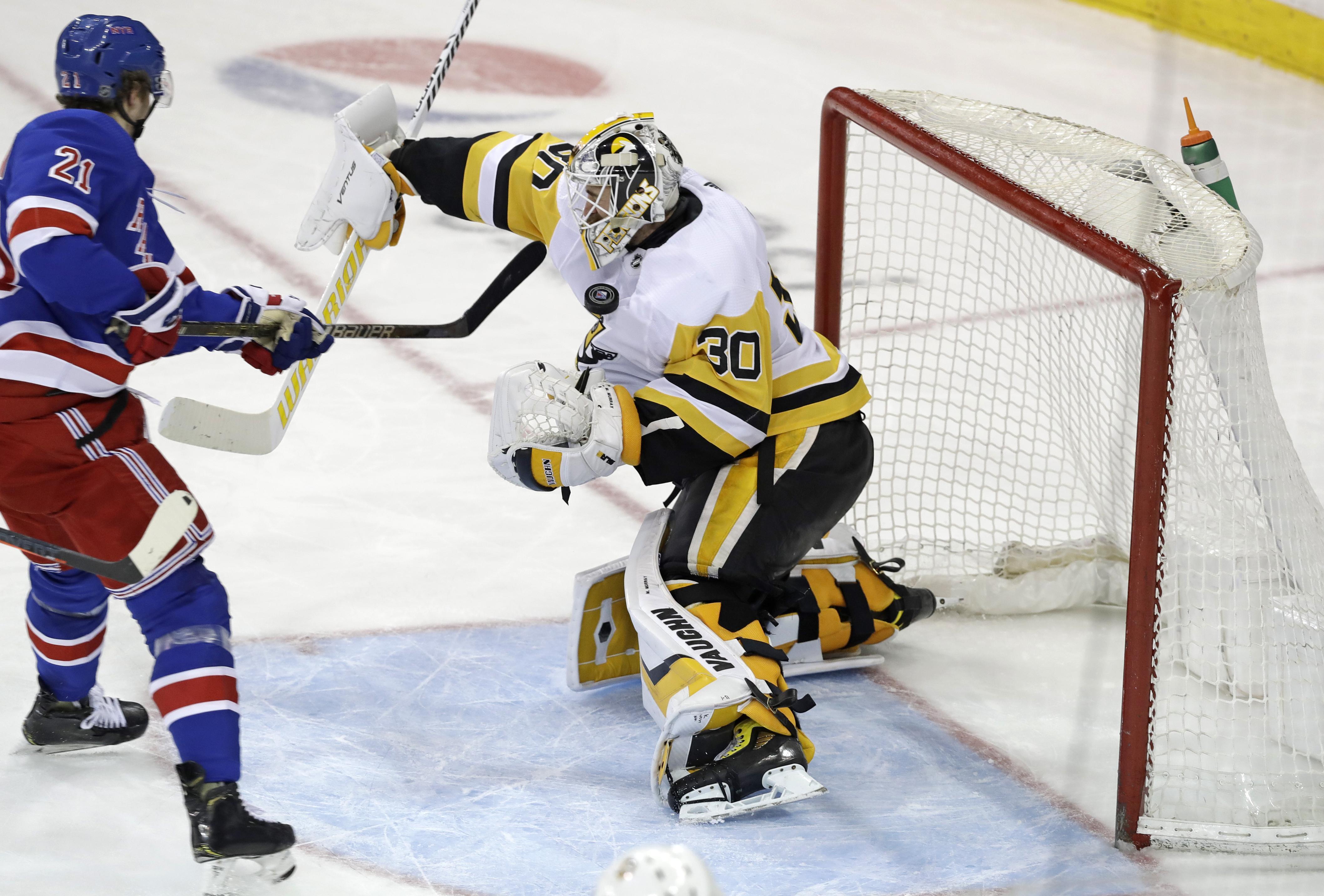 3853e910d Pittsburgh Penguins goaltender Matt Murray uses his left shoulder to block  a shot by New York
