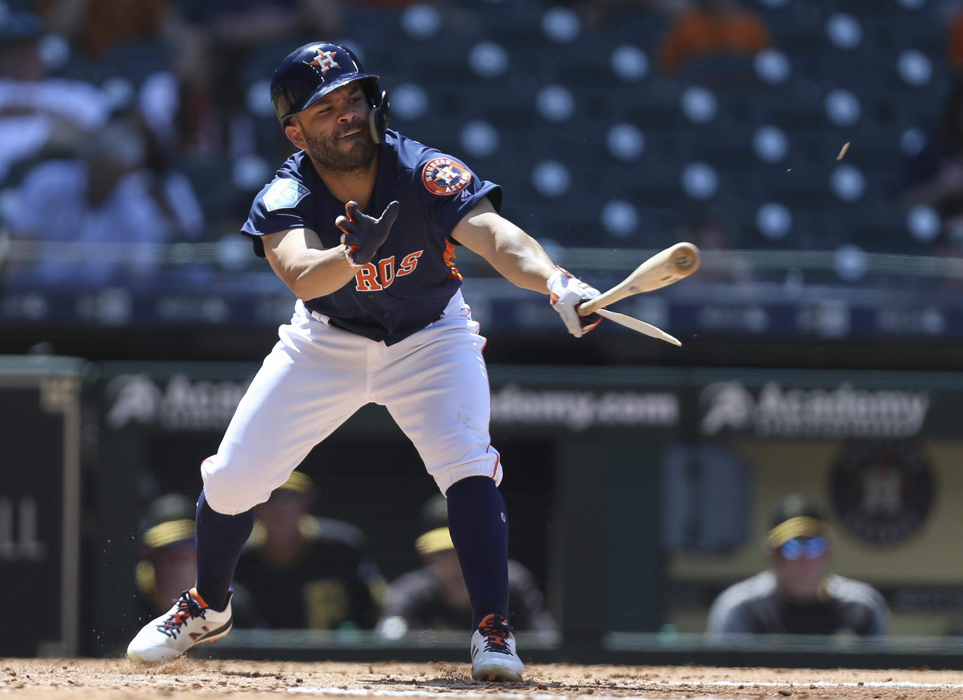 ebedc3ceab0 Houston Astros second baseman Jose Altuve swings and breaks his bat during  an exhibition game on