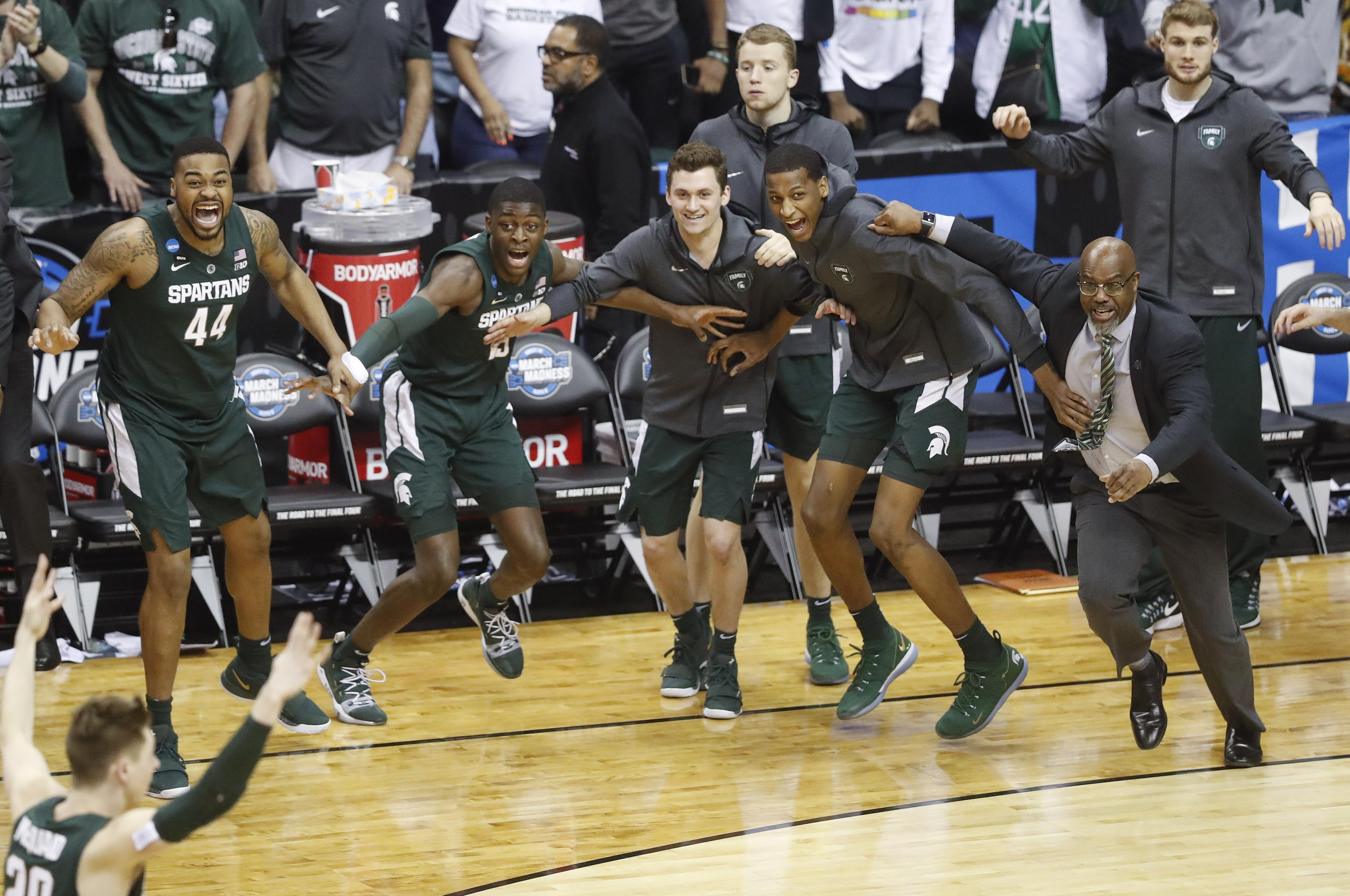 65282f2915f4 Michigan State players begin to celebrate their win over Duke at the end of  the NCAA
