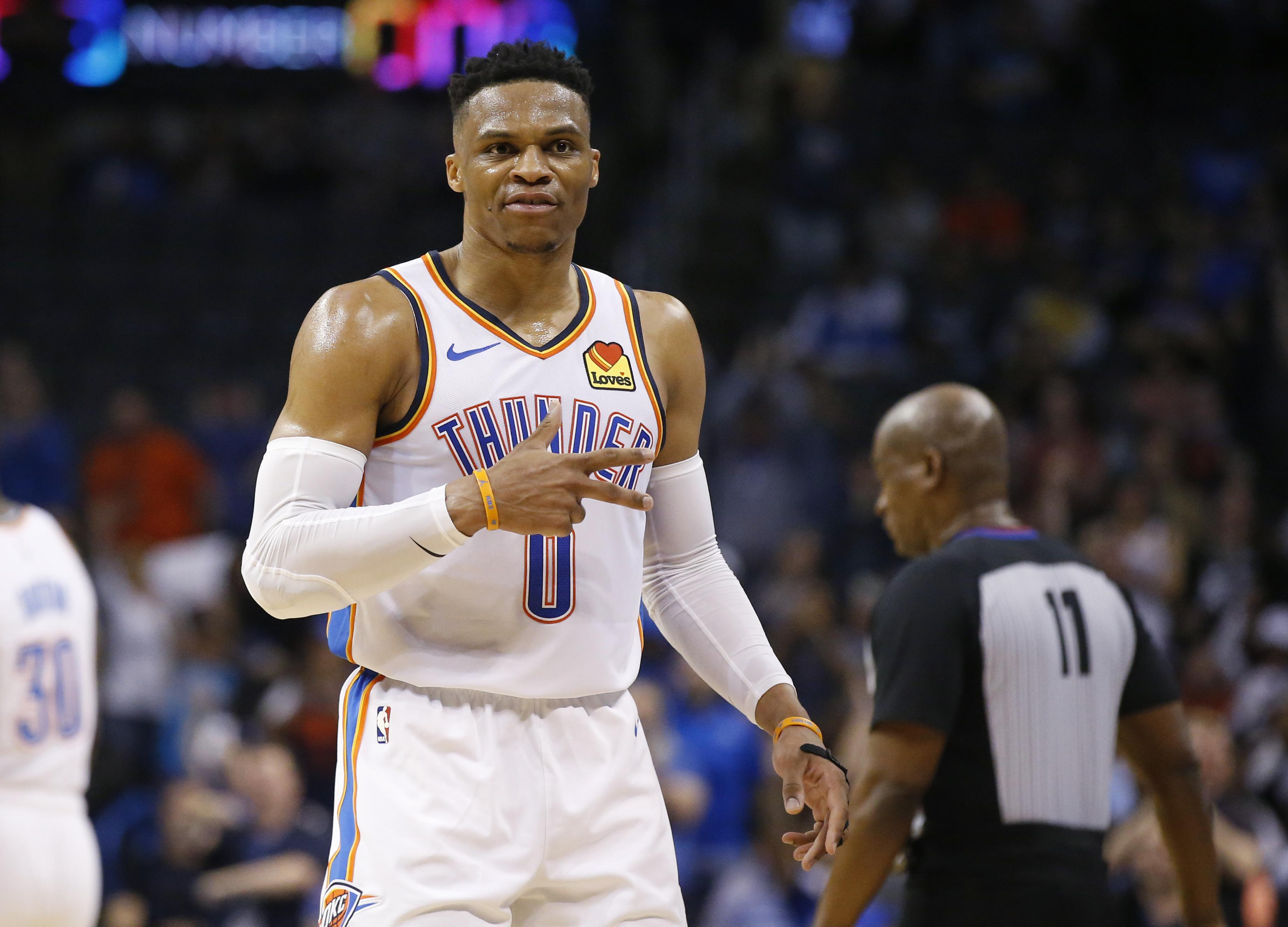 edbaa5d2e6c Oklahoma City Thunder guard Russell Westbrook (0) gestures to the crowd in  the second