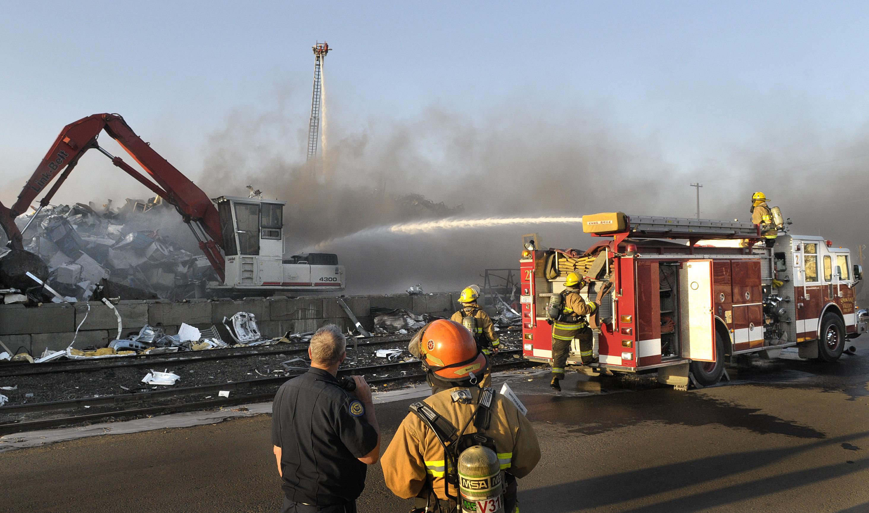 Cutting torch starts fire in large scrap pile at Spokane
