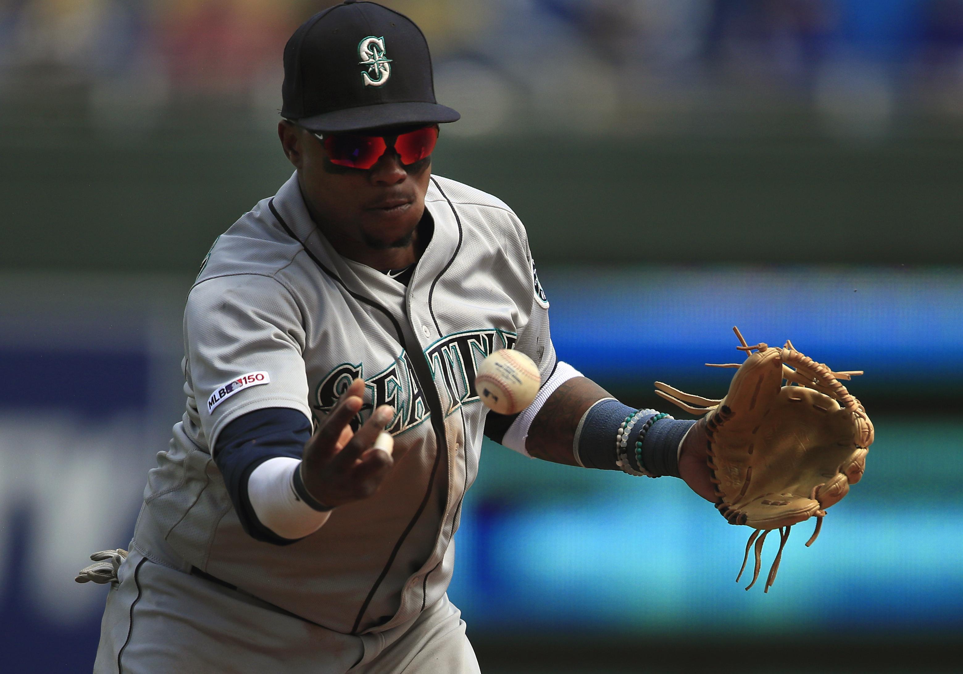 055bb229636 Seattle Mariners shortstop Tim Beckham bobbles a ball hit by Kansas City  Royals designated hitter Jorge