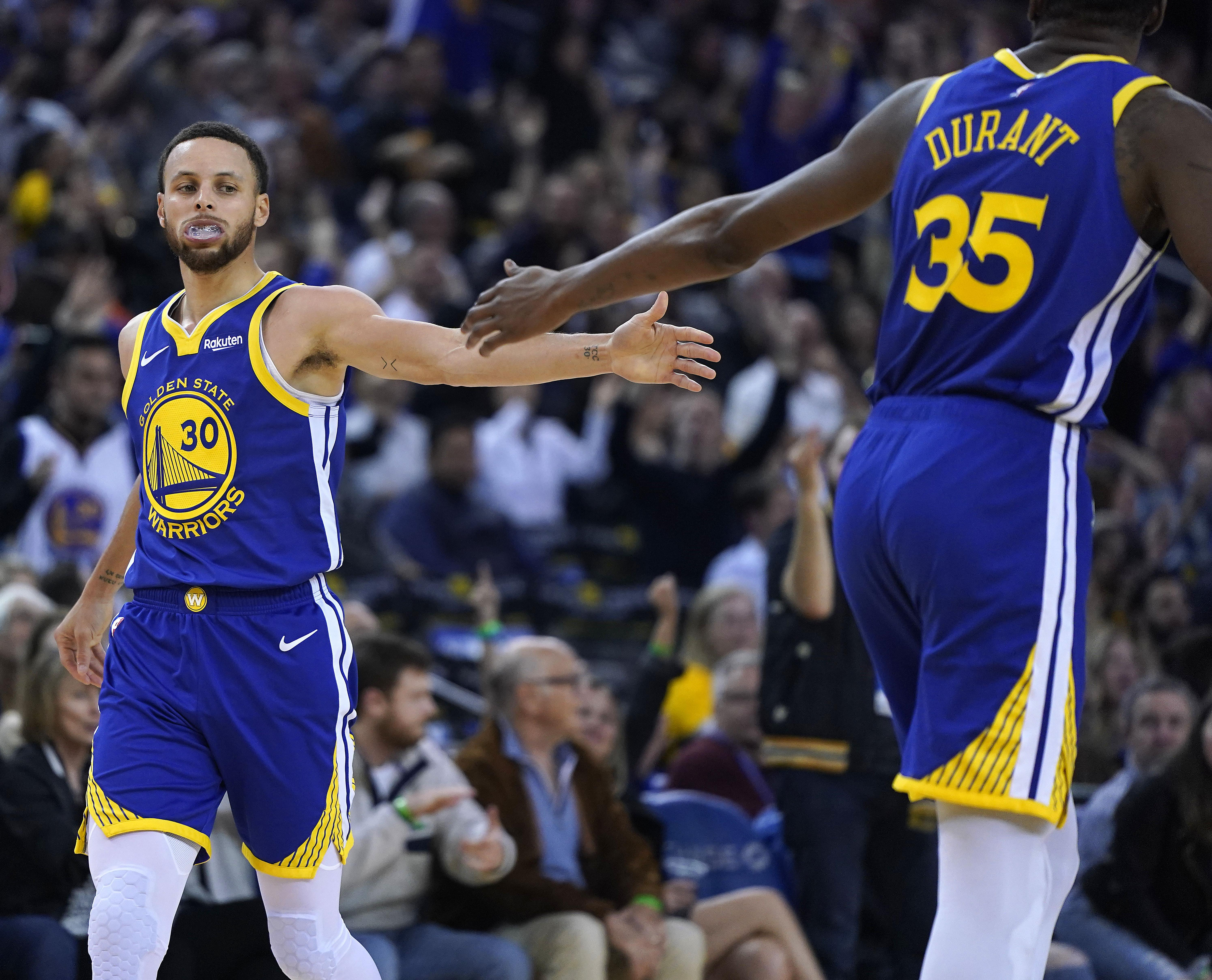 1628250512c Golden State s Kevin Durant congratulates Stephen Curry after Curry made a 3 -pointer against the
