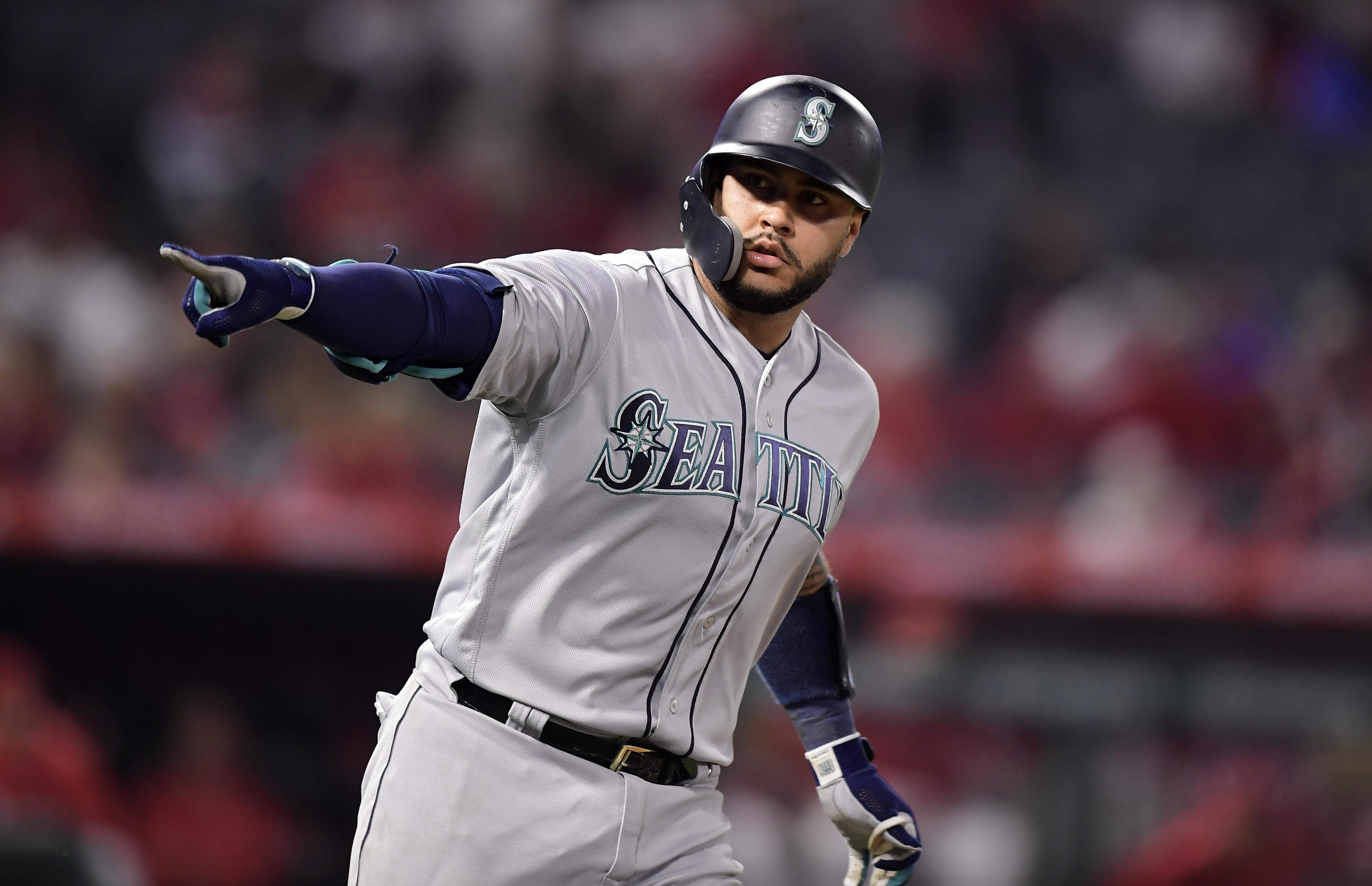 521d33d02 Seattle Mariners  Omar Narvaez points to his dugout as he round first after  hitting a