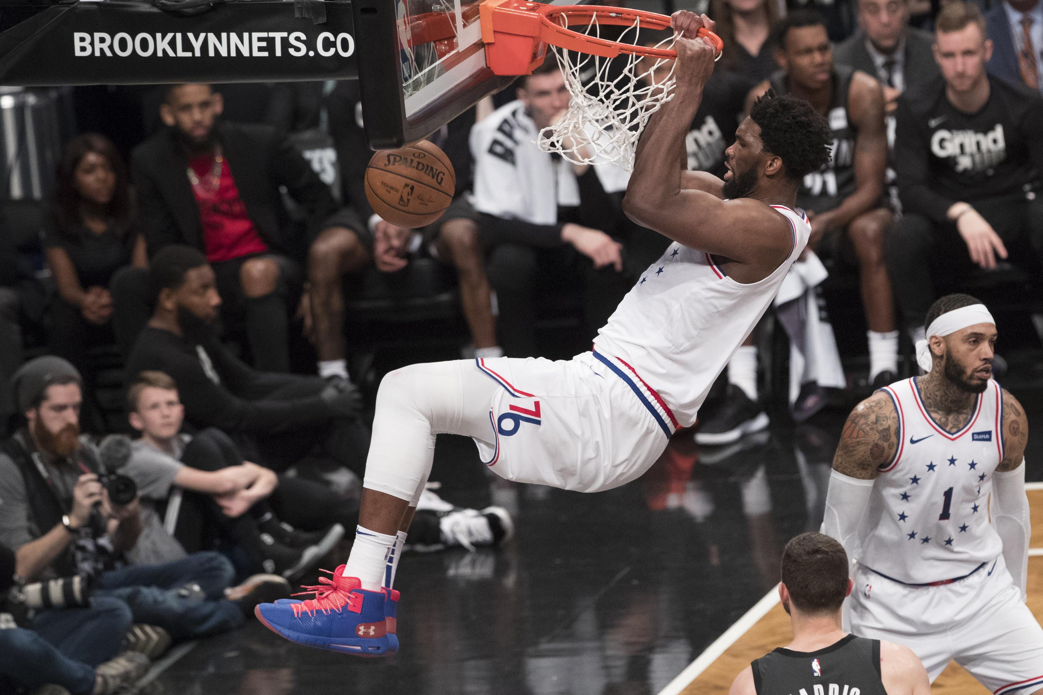 8280c5d6eede Philadelphia 76ers center Joel Embiid dunks during the second half of Game  4 of a first