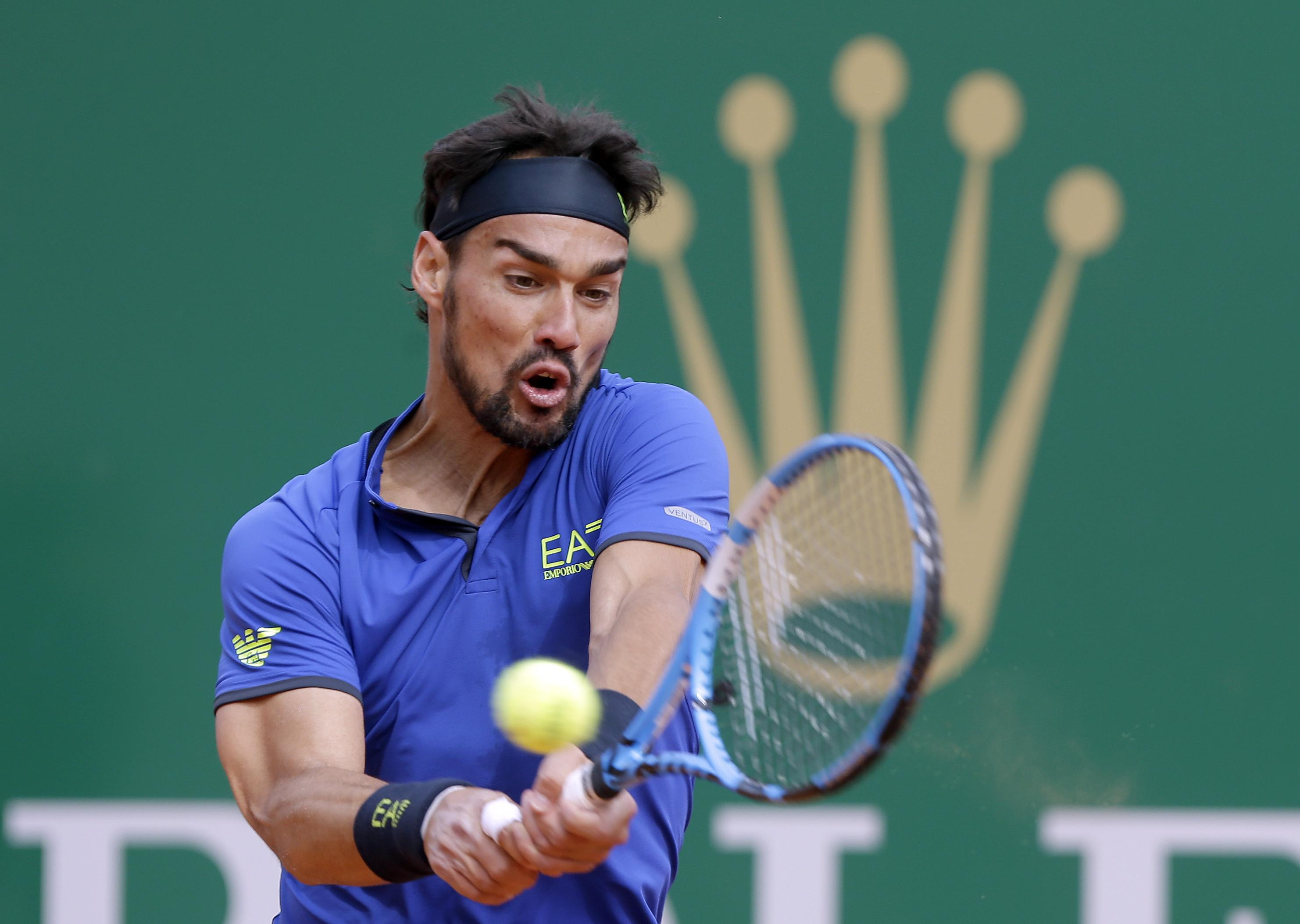 64b4548a034 Italy s Fabio Fognini returns the ball to Spain s Rafael Nadal during their  semifinal match of the
