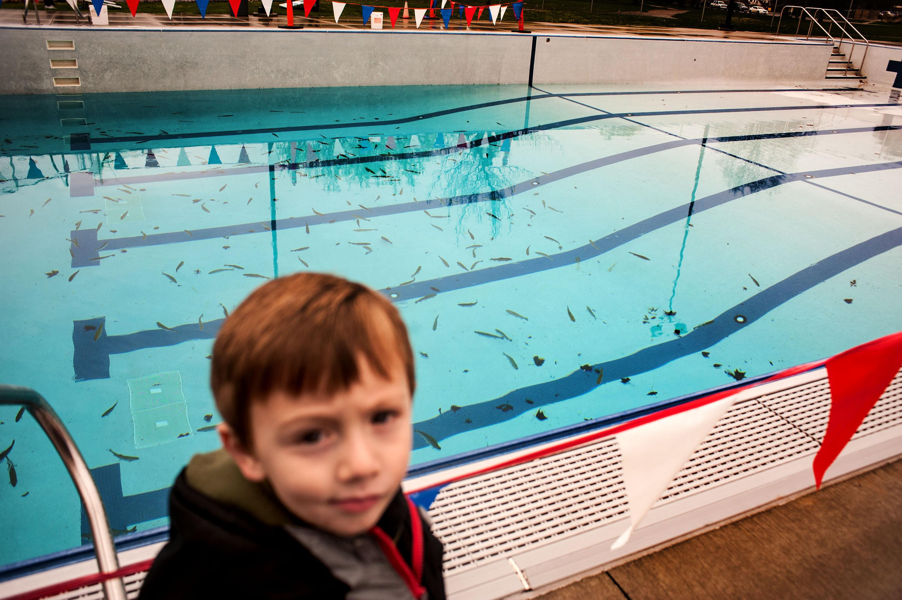 Kids cast their lines at city pool stocked with rainbow ...