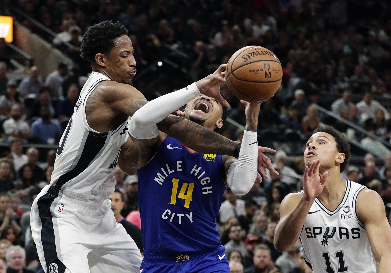 a7a7ee6b56d Denver Nuggets guard Gary Harris (14) is fouled by San Antonio Spurs guard  DeMar
