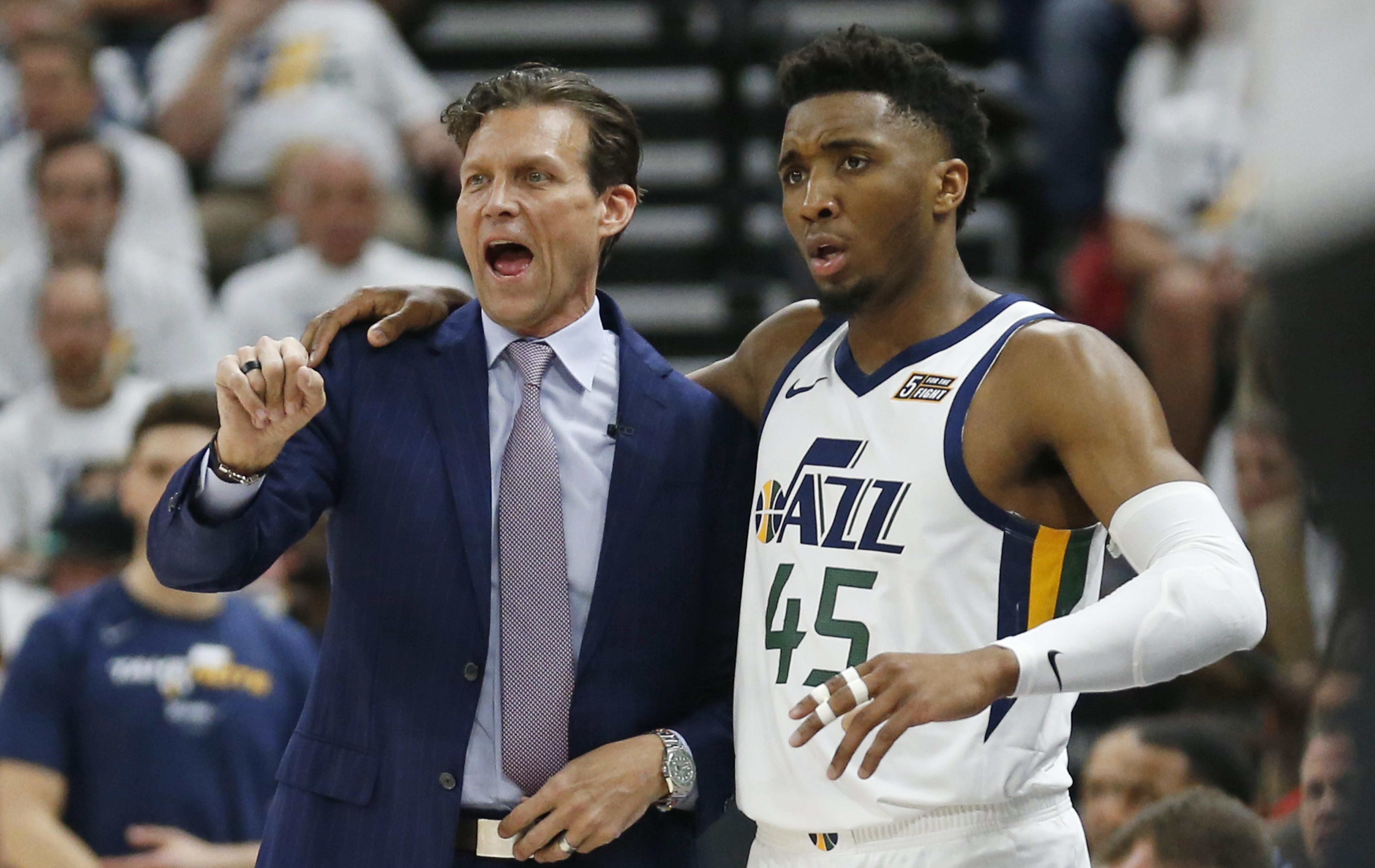 0edc205a9ed0 Utah Jazz head coach Quin Snyder and guard Donovan Mitchell (45) speak in  the