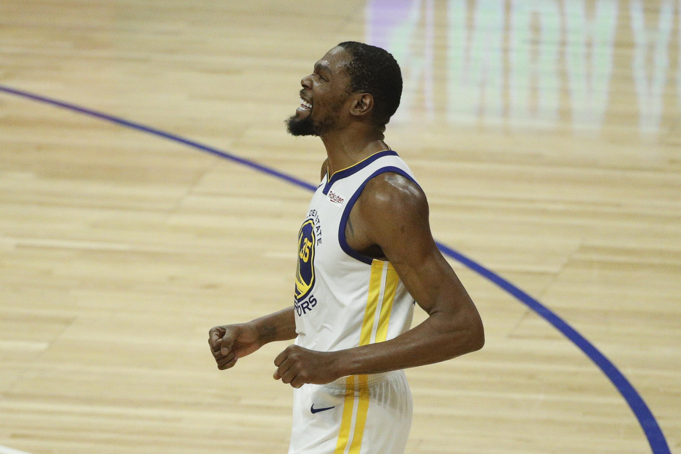 8bfb024028f Golden State Warriors  Kevin Durant reacts after making a three-point  basket during the